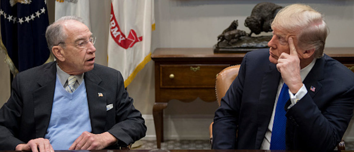 US President Donald Trump (R) speaks with US Senator Chuck Grassley (L), R-Iowa, during a meeting with Republican members of the Senate about immigration at the White House in Washington, DC, on January 4, 2018. / AFP PHOTO / JIM WATSON (Photo credit should read JIM WATSON/AFP/Getty Images)