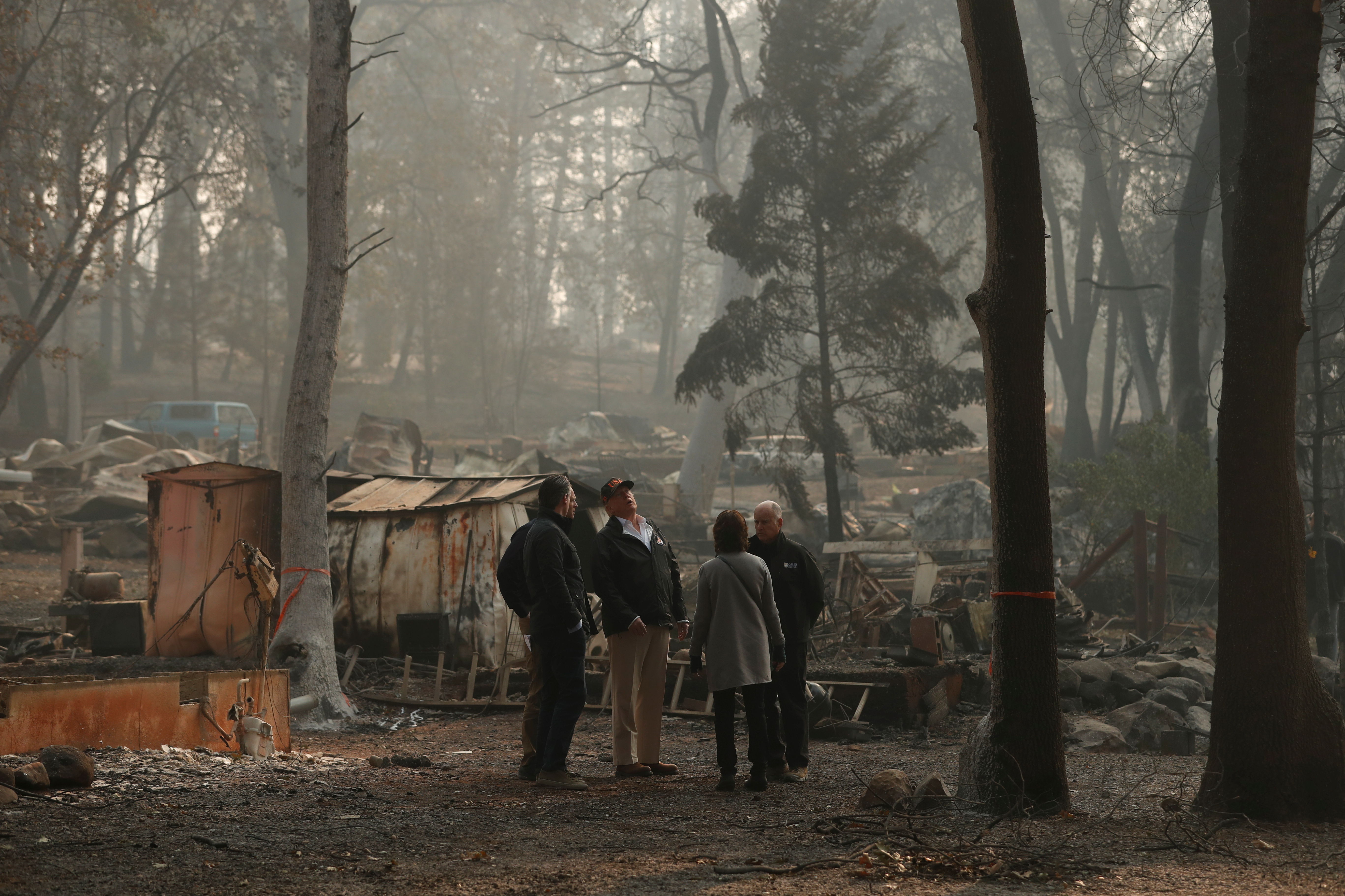 U.S. President Donald Trump visits the charred wreckage of Skyway Villa Mobile Home and RV Park with Governor-elect Gavin Newsom (L), FEMA head Brock Long (2nd L), Paradise Mayor Jody Jones (2n R) and Governor Jerry Brown in Paradise, California, U.S., November 17, 2018. REUTERS/Leah Millis