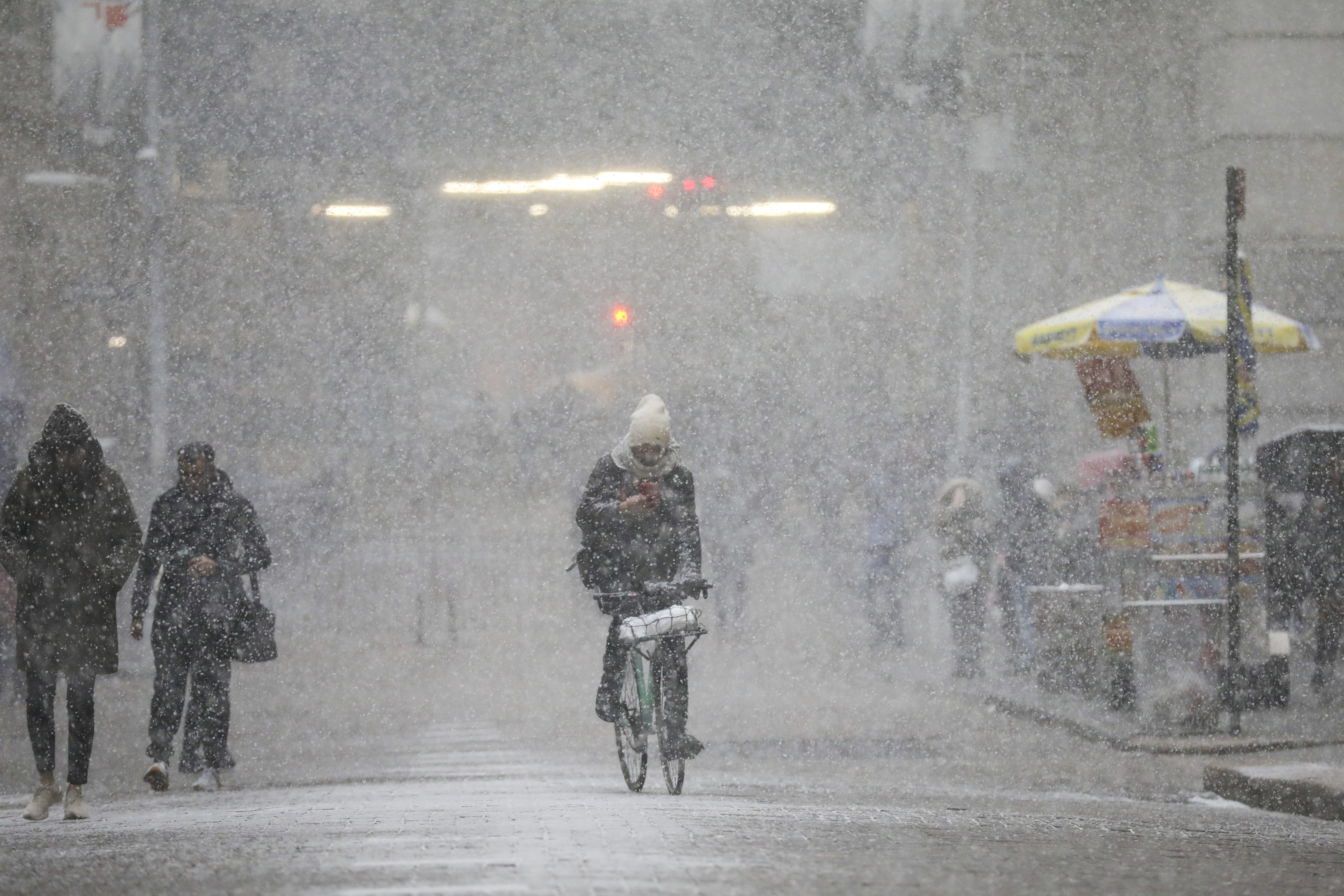 NEW YORK, NY - JANUARY 30: A cyclist rides through the falling snow in the Financial District, January 30, 2019 in New York City. The frigid air from the polar vortex in the Midwest will expand into the New York over the next few days. (Photo by Drew Angerer/Getty Images)