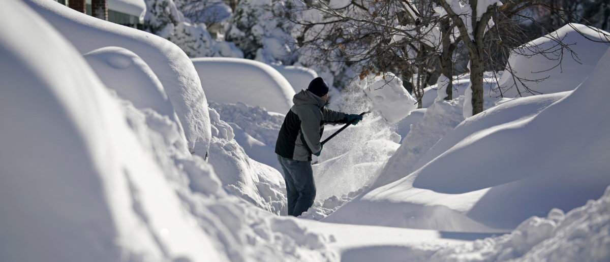 A resident shovels snow away from the entrance to his home in Union City, New Jersey, across the Hudson River from Midtown Manhattan, after the second-biggest winter storm in New York history, January 24, 2016. REUTERS/Rickey Rogers
