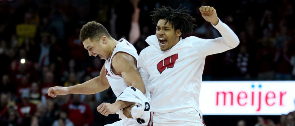 MADISON, WISCONSIN - JANUARY 19: Kobe King #23 and Tai Strickland #13 of the Wisconsin Badgers celebrate after beating the Michigan Wolverines 64-54 at the Kohl Center on January 19, 2019 in Madison, Wisconsin. (Photo by Dylan Buell/Getty Images)