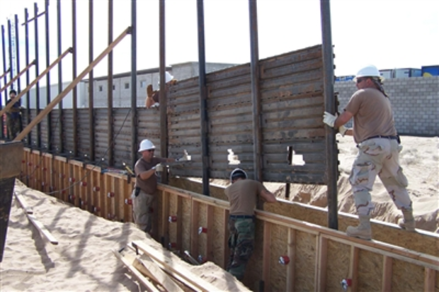 Arkansas National Guard building a wall (Department of Defense photo) https://media.defense.gov/2006/Oct/06/2001245115/-1/-1/0/619868-U-NEX55-011.jpg