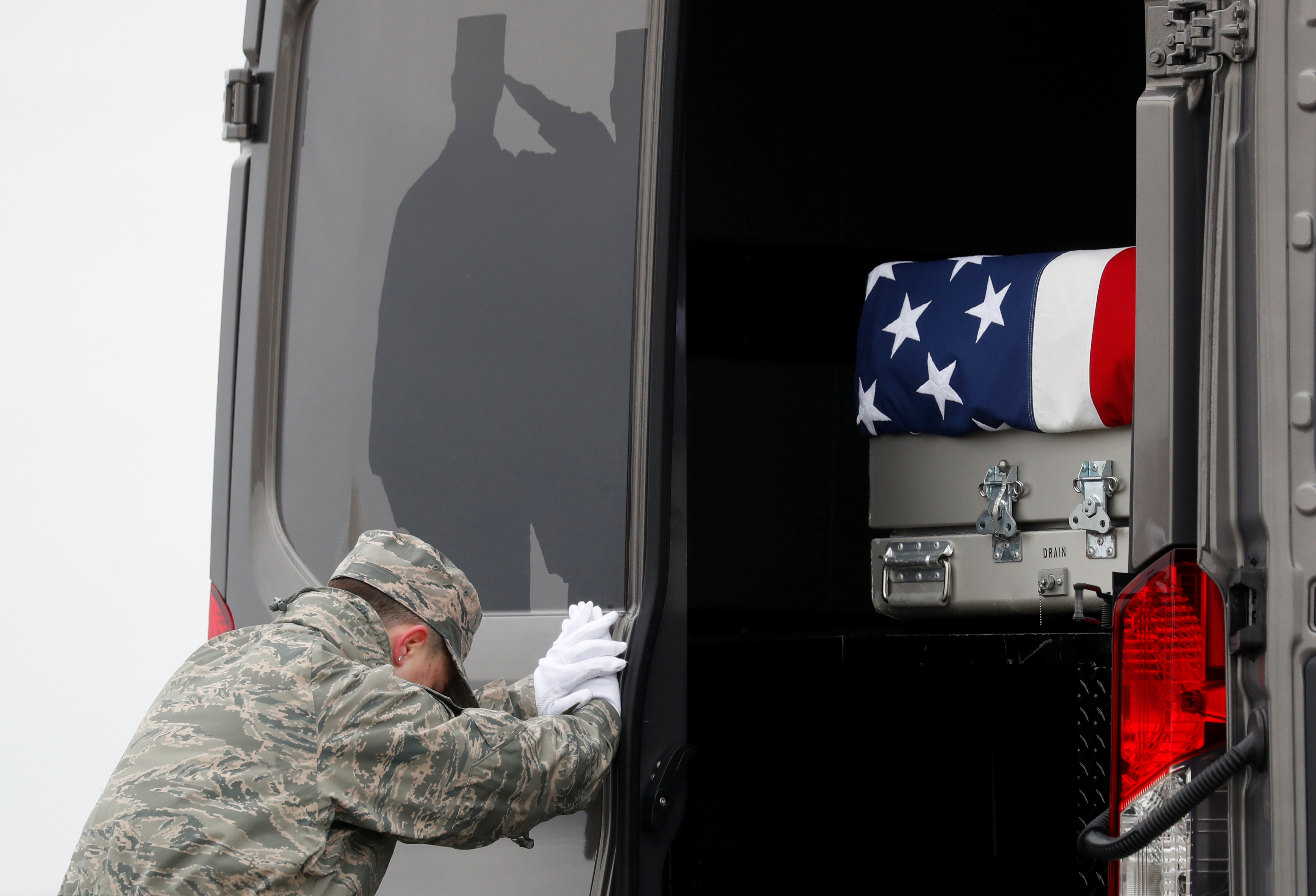 The casket carrying the remains of Scott Wirtz, a civilian employee of the U.S. Defense Intelligence Agency killed along with three members of the U.S. military during a recent attack in Syria, is placed in a military vehicle during a dignified transfer ceremony attended by U.S. President Donald Trump as they are returned to the United States at Dover Air Force Base, in Dover, Delaware, U.S., January 19, 2019. REUTERS/Kevin Lamarque
