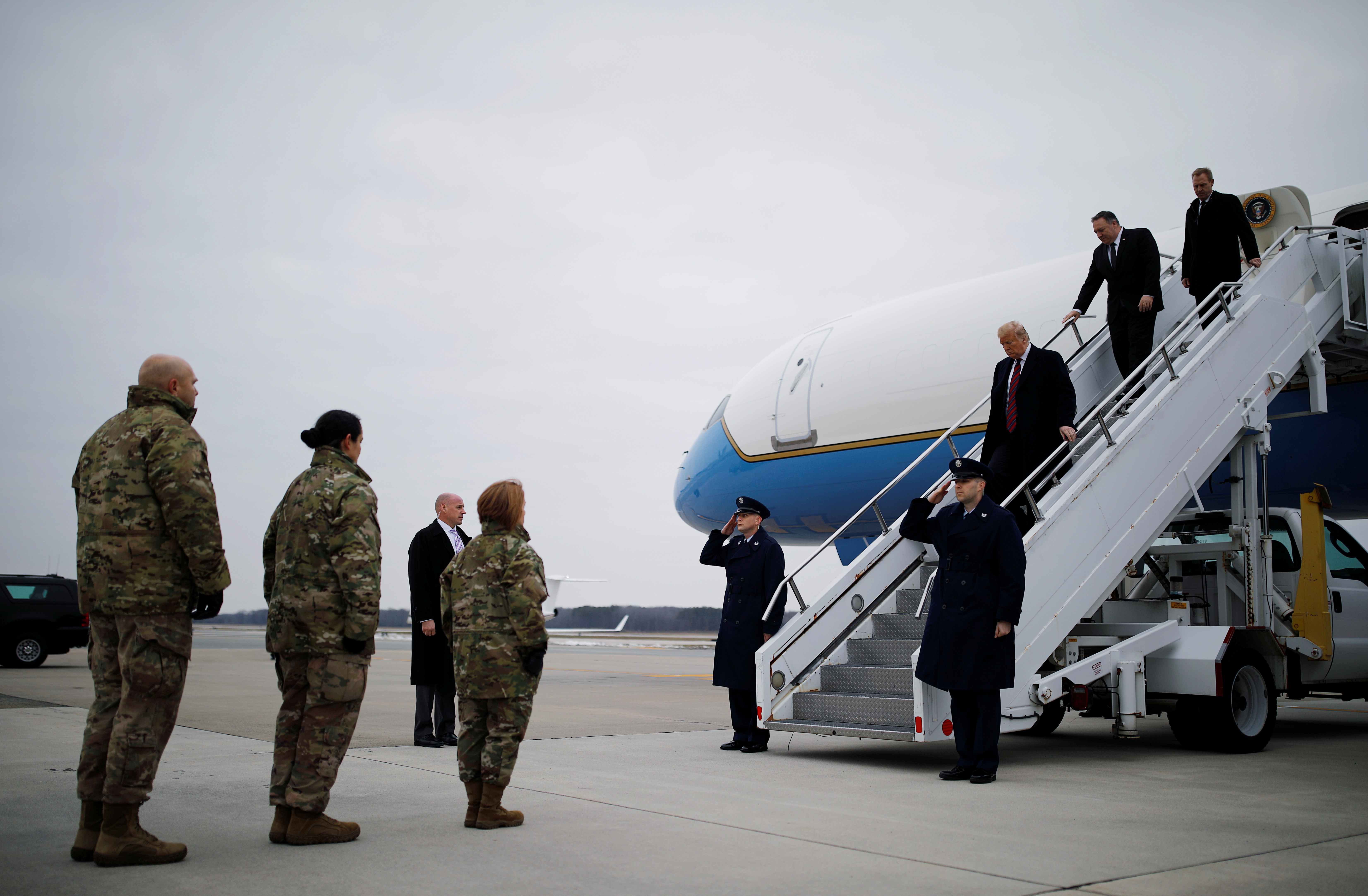 U.S. President Donald Trump exits Air Force One as he arrives at Dover Air Force Base to attend the dignified transfer ceremonies for the remains of four U.S. military members and citizens killed during a recent attack in Syria now being returned to the United States, in Dover, Delaware, U.S., January 19, 2019. REUTERS/Carlos Barria