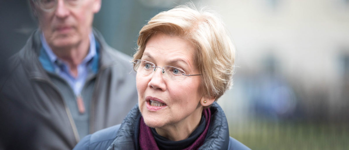 Sen. Elizabeth Warren (D-MA), addresses the media outside of her home after announcing she formed an exploratory committee for a 2020 Presidential run on December 31, 2018 in Cambridge, Massachusetts. (Photo by Scott Eisen/Getty Images)