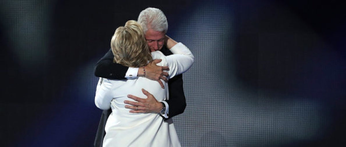PHILADELPHIA, PA - JULY 28: Democratic presidential candidate Hillary Clinton is embraced by her husband, former US President Bill Clinton, at the end of the fourth day of the Democratic National Convention at the Wells Fargo Center, July 28, 2016 in Philadelphia, Pennsylvania. Photo by Alex Wong/Getty Images