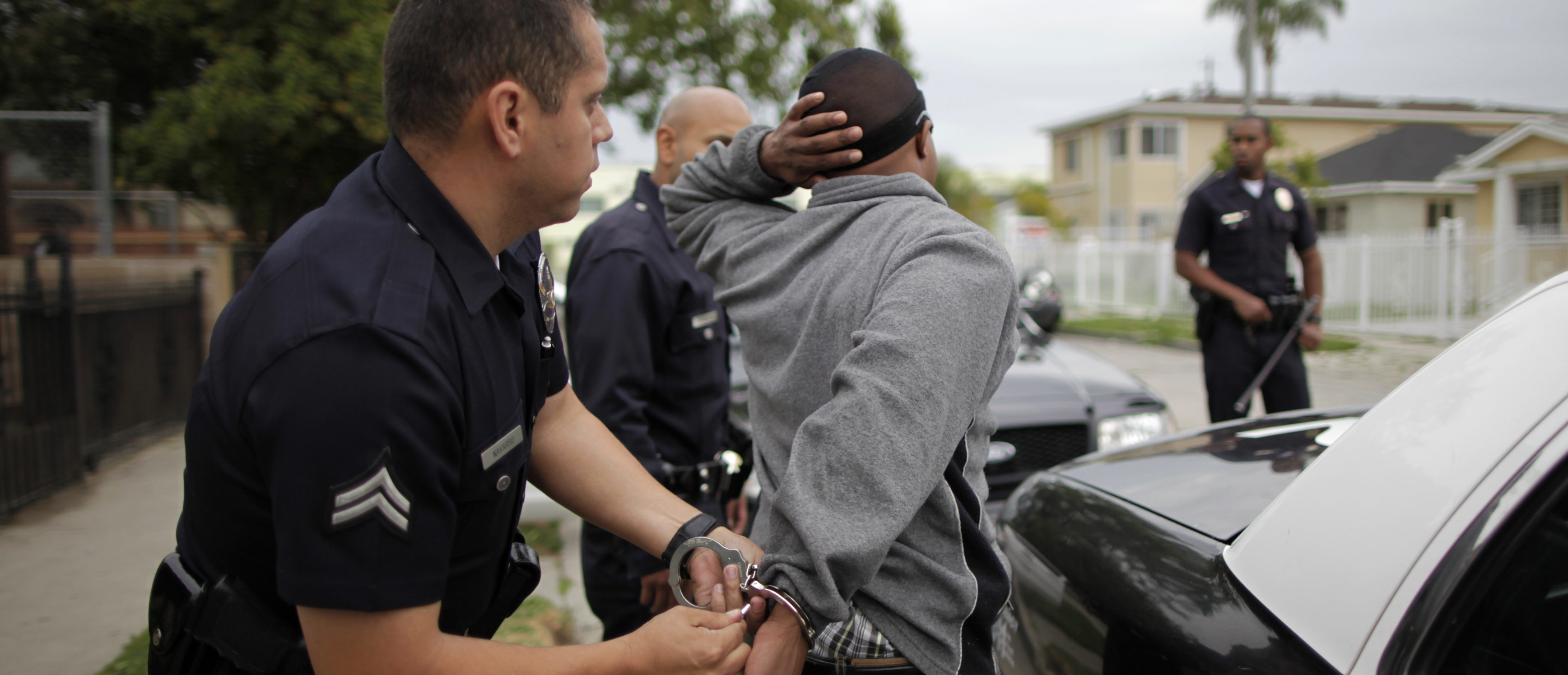 A man is handcuffed in south Los Angeles, California, April 25, 2012. This April 29 will mark the 20th anniversary of the Los Angeles Riots following the acquittal of four Los Angeles police officers in the videotaped beating of motorist Rodney King. The 77th division of south Los Angeles, where the riots began, is an 11.2 square mile area. It has seen a drop from 162 homicides 20 years ago, to 16 so far this year. There are around 34 gangs operating in the division. REUTERS/Lucy Nicholson
