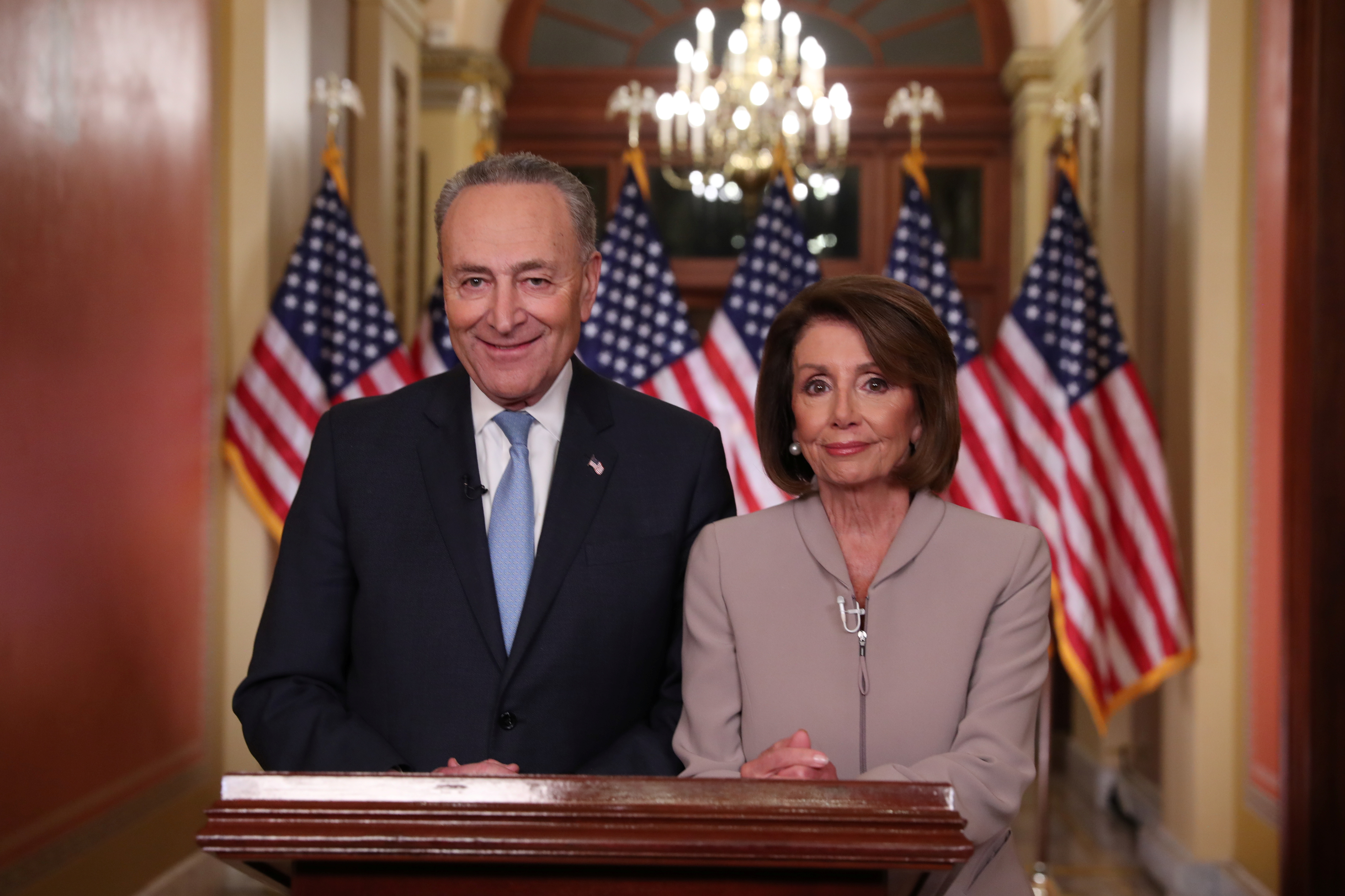 U.S. Speaker of the House Nancy Pelosi and Senate Minority Leader Chuck Schumer pose for photographers after concluding their joint response, to President Trump's prime time address, on Capitol Hill in Washington, U.S., January 8, 2019. REUTERS/Jonathan Ernst