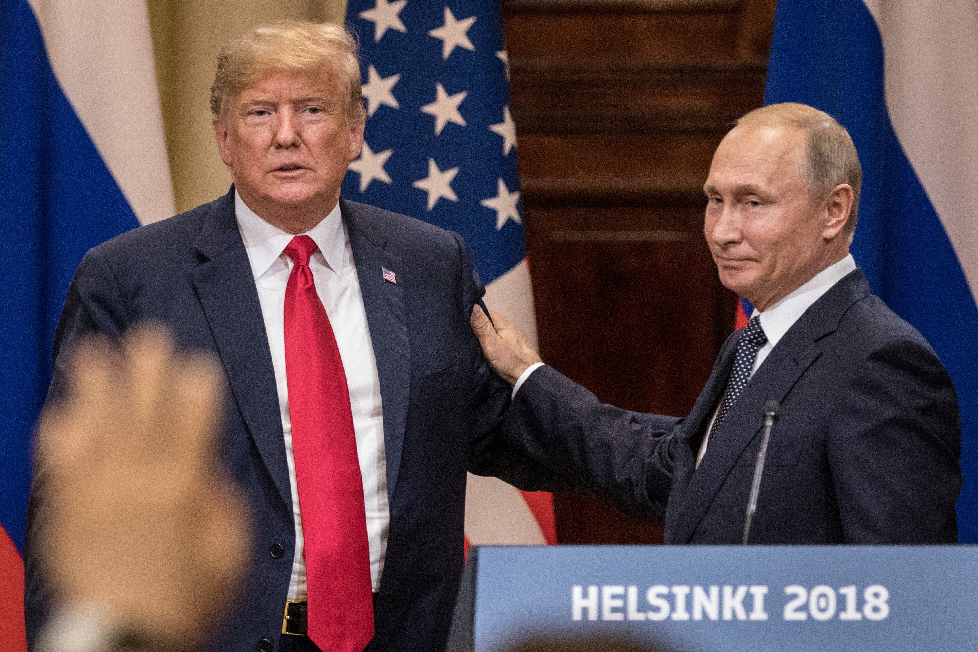 U.S. President Donald Trump (L) and Russian President Vladimir Putin shake hands during a joint press conference after their summit on July 16, 2018 in Helsinki, Finland. Chris McGrath/Getty Images