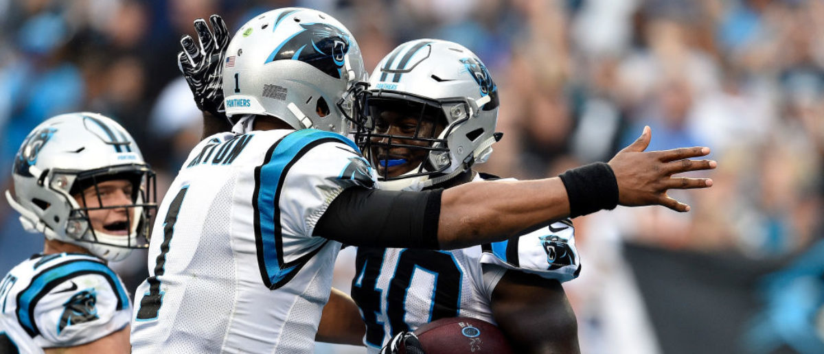 CHARLOTTE, NC - SEPTEMBER 09: Alex Armah #40 and teammate Cam Newton #1 of the Carolina Panthers celebrate a touchdown against the Dallas Cowboys in the fourth quarter during their game at Bank of America Stadium on September 9, 2018 in Charlotte, North Carolina. (Photo by Grant Halverson/Getty Images)