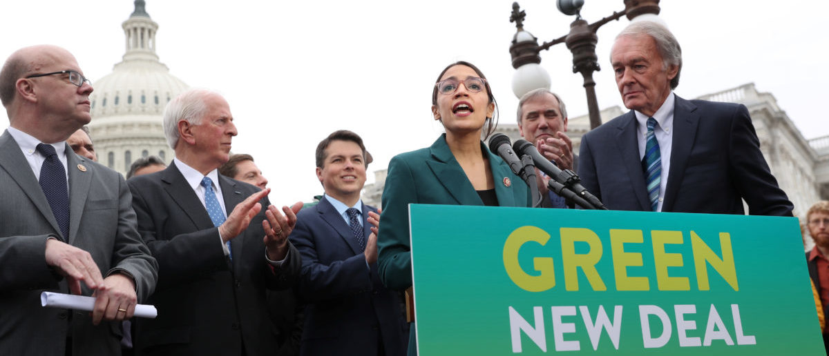 """U.S. Rep. Alexandria Ocasio-Cortez and Sen. Ed Markey hold a news conference for their proposed """"Green New Deal"""" to achieve net-zero greenhouse gas emissions in 10 years, at the U.S. Capitol in Washington, U.S., Feb. 7, 2019. REUTERS/Jonathan Ernst"""