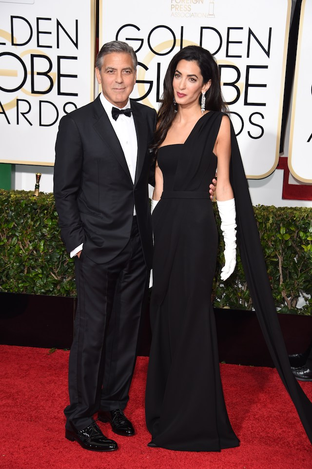Actor George Clooney (L) and Amal Clooney arrive on the red carpet for the 72nd annual Golden Globe Awards, January 11, 2015 at the Beverly Hilton Hotel in Beverly Hills, California. (Photo credit:MARK RALSTON/AFP/Getty Images)
