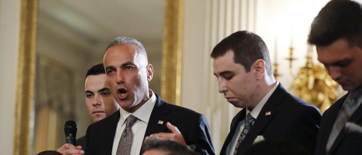 Marjory Stoneman Douglas High School parent Andrew Pollack discusses the death of his daughter Meadow in the Parkland school shooting as he and his sons attend a listening session on school safety and shootings with U.S. President Donald Trump at the White House in Washington, U.S., February 21, 2018. REUTERS/Jonathan Ernst