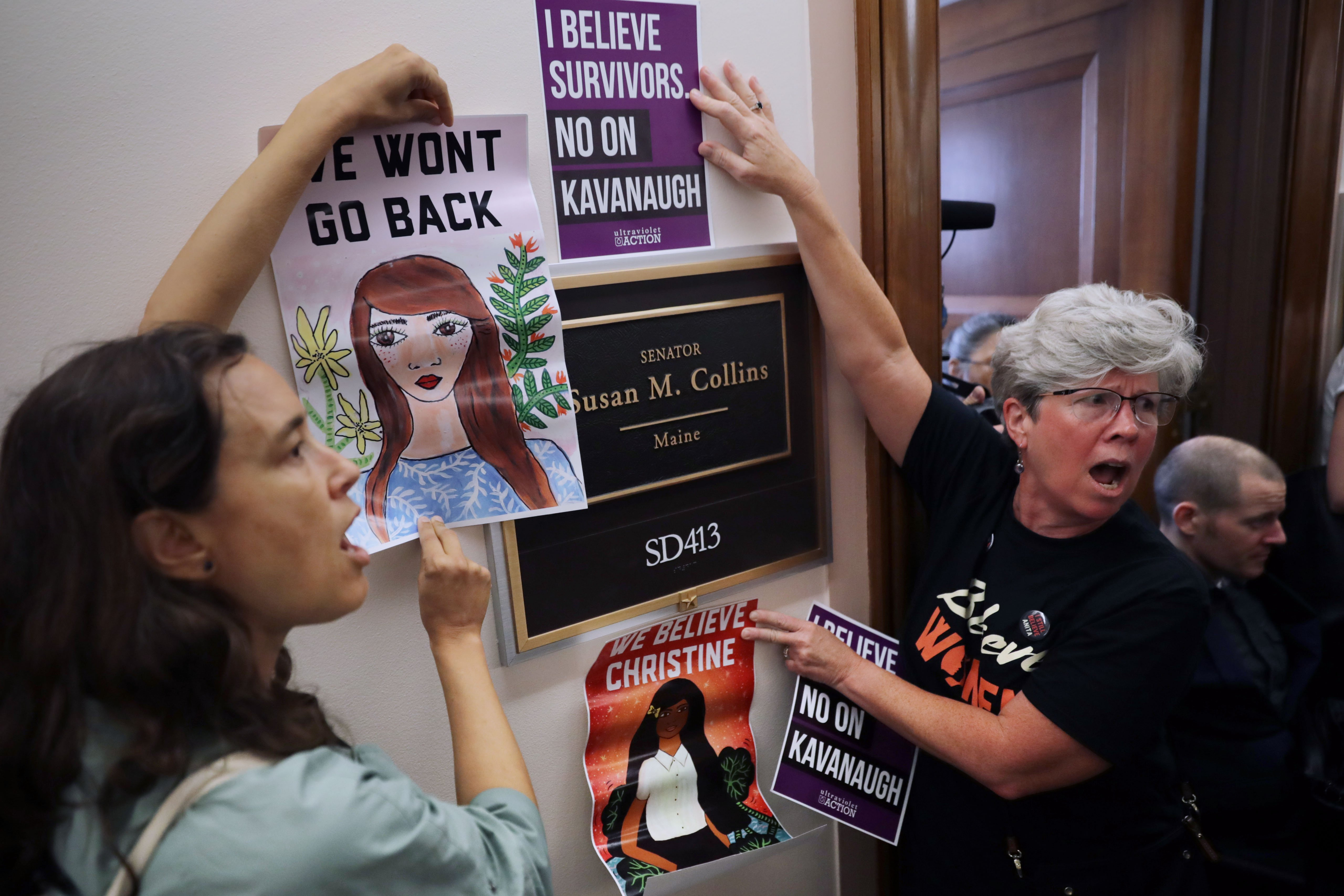 Dozens of protesters demonstrate against the appointment Brett Kavanaugh outside the offices of Sen. Susan Collins (R-ME) in the Dirksen Senate Office Building on Capitol Hill September 26, 2018. (Chip Somodevilla/Getty Images)