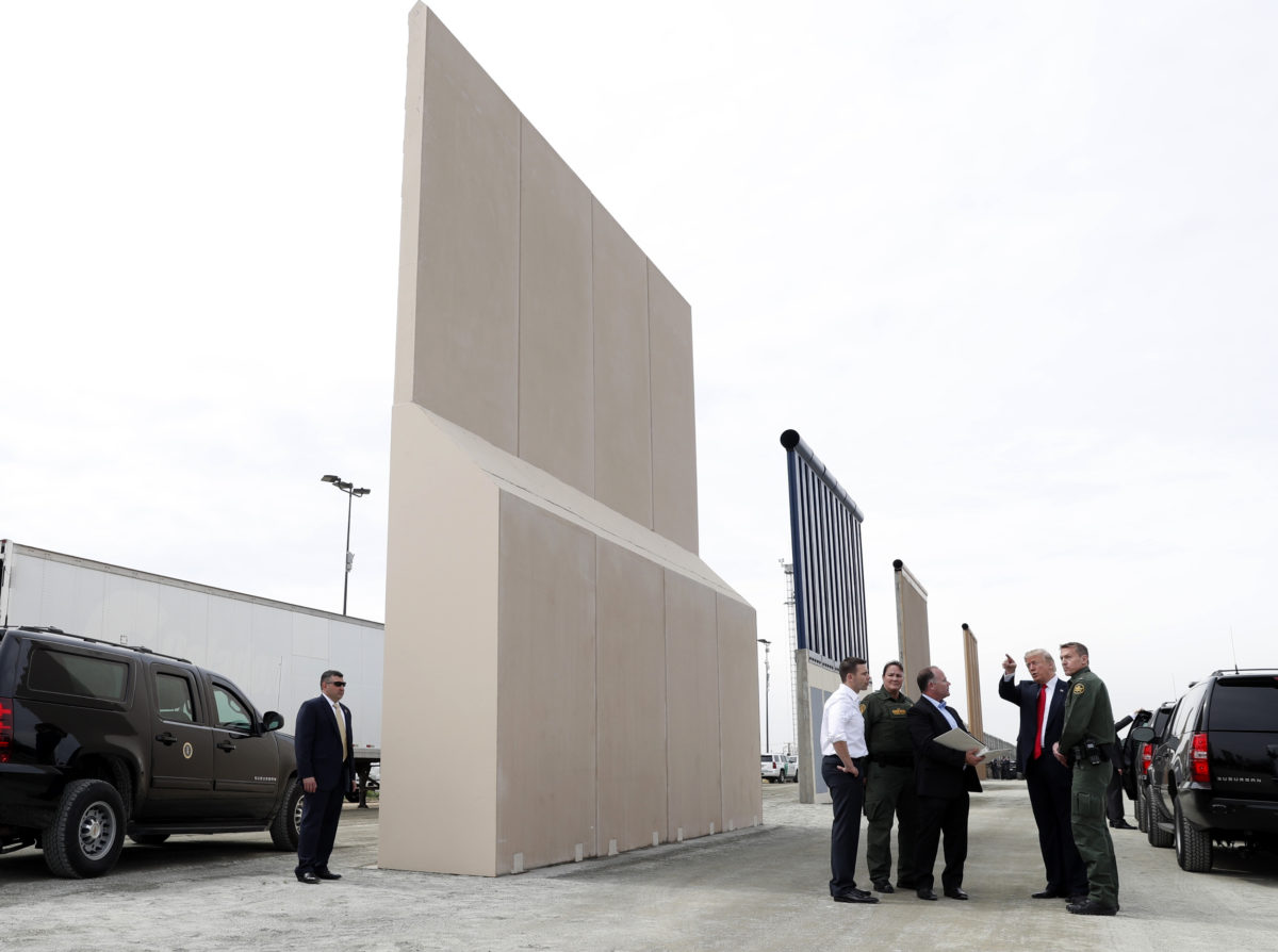 U.S. President Donald Trump participates in a tour of U.S.-Mexico border wall prototypes near the Otay Mesa Port of Entry in San Diego, California. U.S., March 13, 2018. REUTERS/Kevin Lamarque