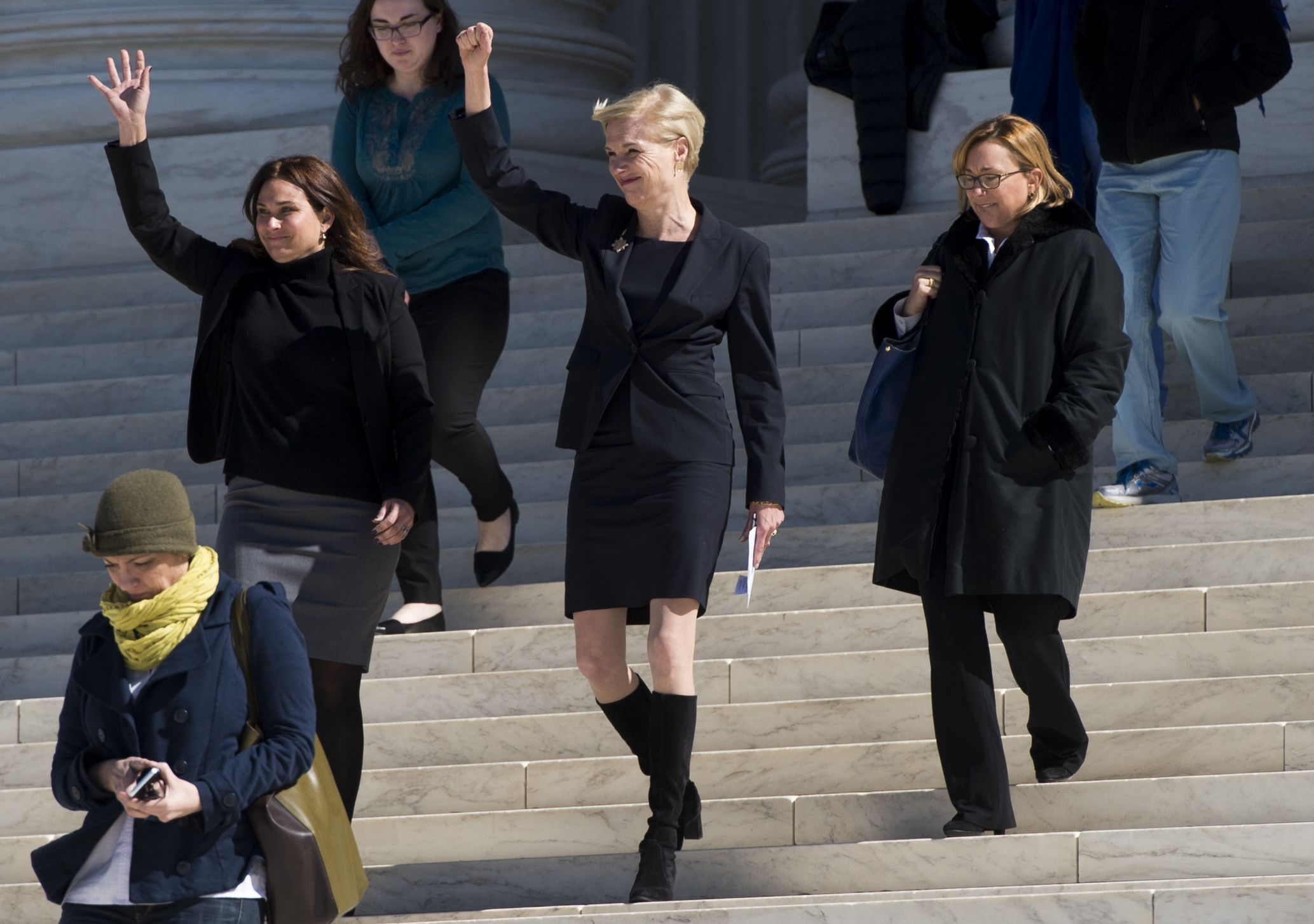 Cecile Richards (C), president of Planned Parenthood, acknowledges supporters as she leaves the Supreme Court in Washington, DC, March 2, 2016, following oral arguments in Whole Woman's Health v. Hellerstedt (Saul Loeb/AFP/Getty Images)
