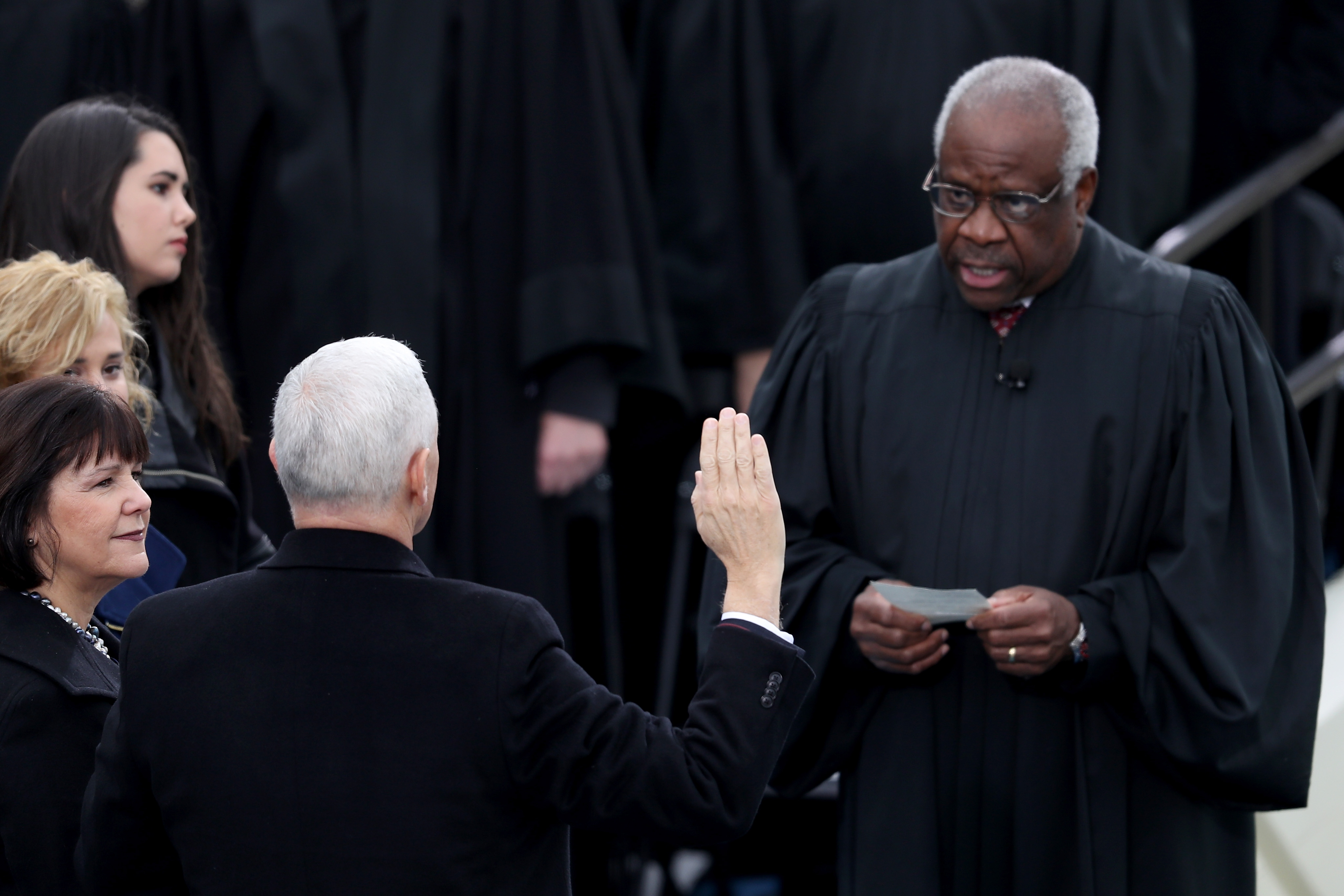 Vice President Mike Pence takes the oath of office from Justice Clarence Thomas. (Joe Raedle/Getty Images)
