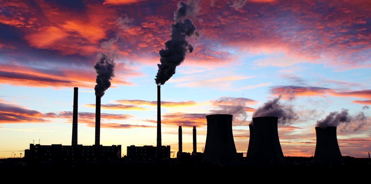 Dramatic sunset on the sky and coal power plant factory. Shutterstock