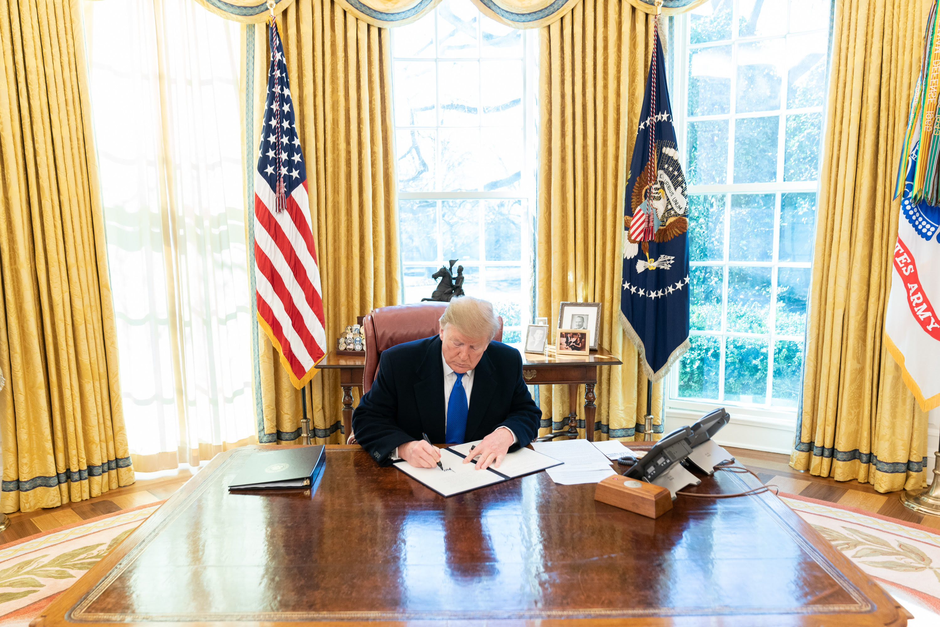"""President Donald J. Trump signs a presidential proclamation on """"Declaring a National Emergency Concerning the Southern Border of the United States."""" (Official White House Photo/Shealah Craighead)"""