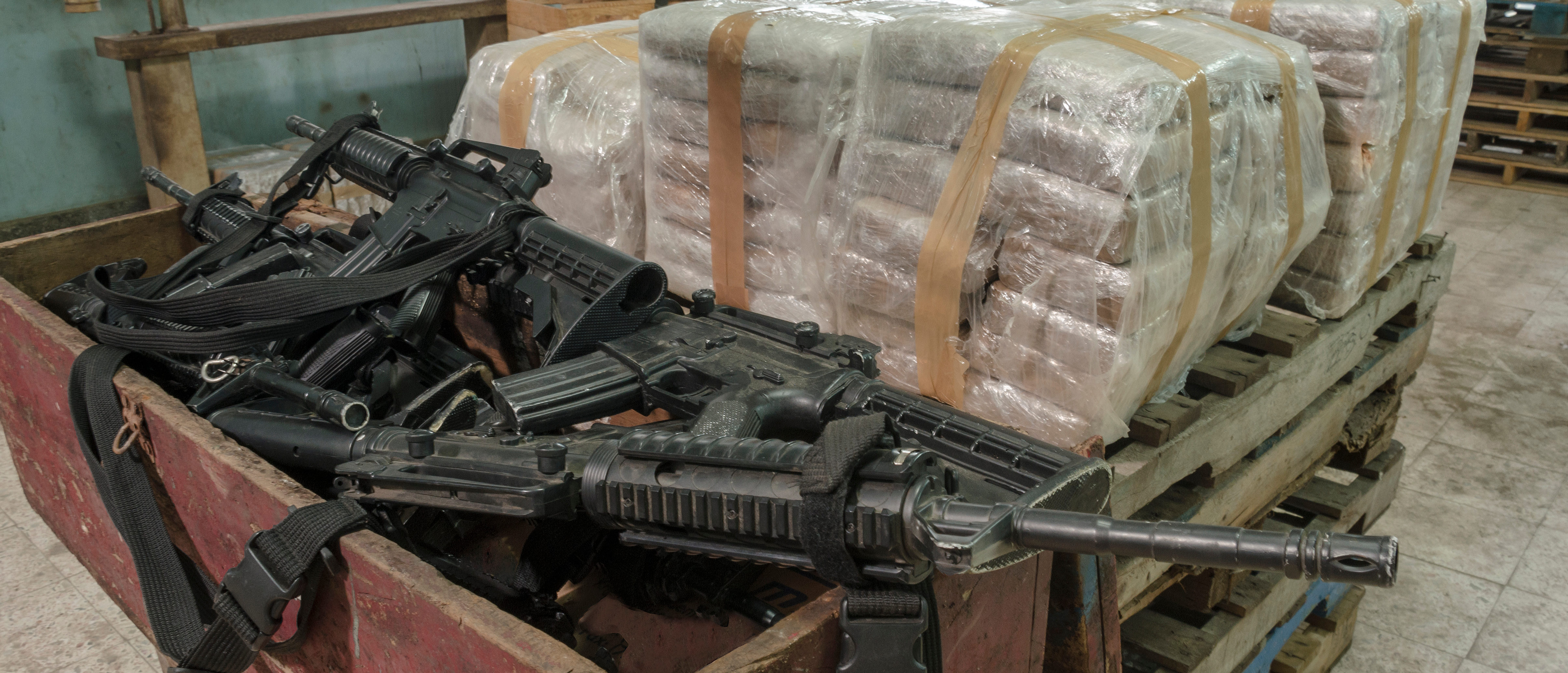 Drugs and guns (Shutterstock/Leon Rafael)