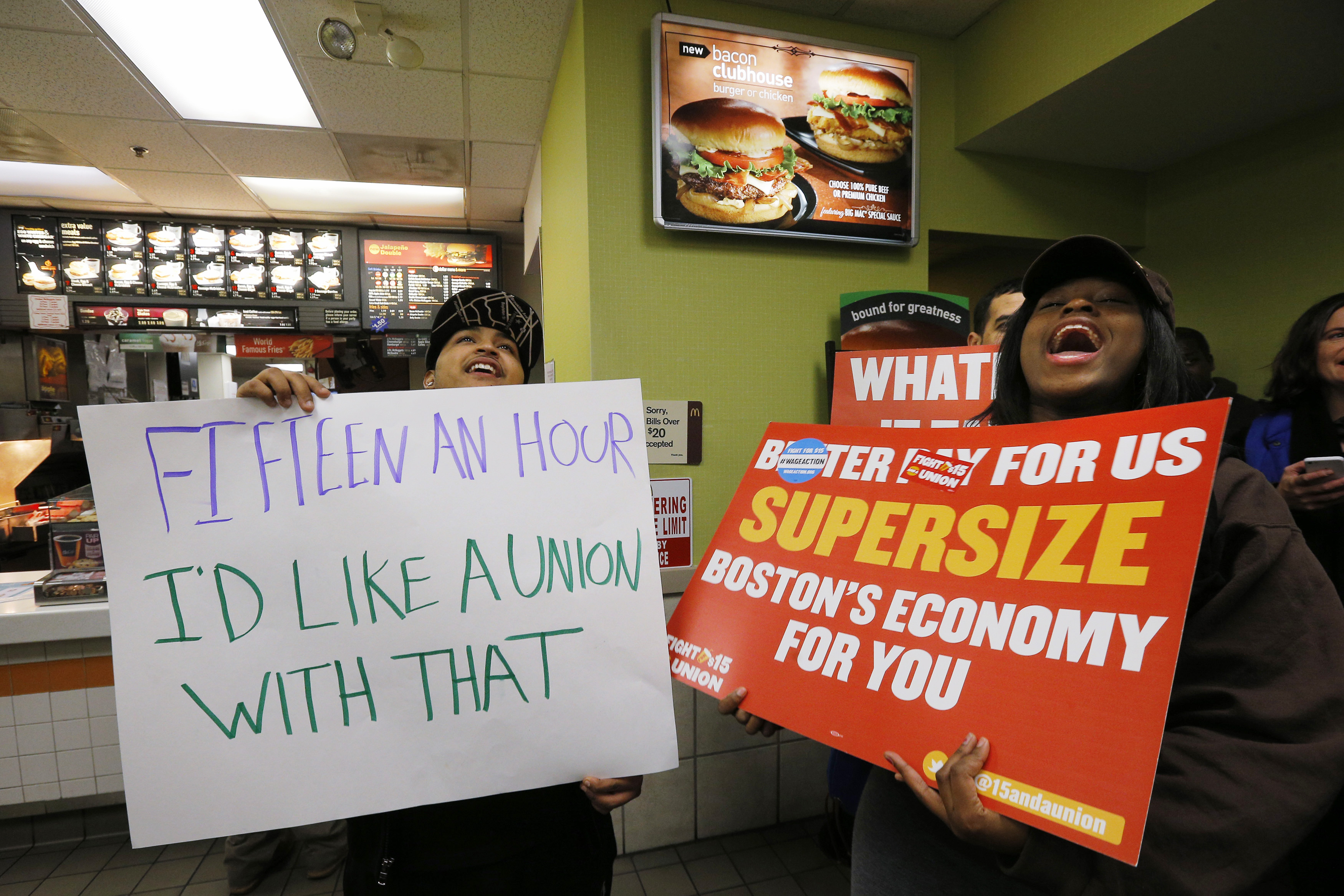 "Scores of fast food workers and their supporters calling for a $15 minimum wage fill a McDonalds restaurant in Chelsea, Massachusetts December 4, 2014. Workers in the fast-food, home care and airline industries are staging protests and strikes throughout the United States on Thursday to advocate for a $15 minimum wage and other labor rights. The protests are under a banner organization called ""Fight for 15"" and organizers say they expect Thursday's actions will represent the most expansive to date, increasing to a planned 160 cities from 150 in a similar nationwide protest in early September. REUTERS/Brian Snyder"