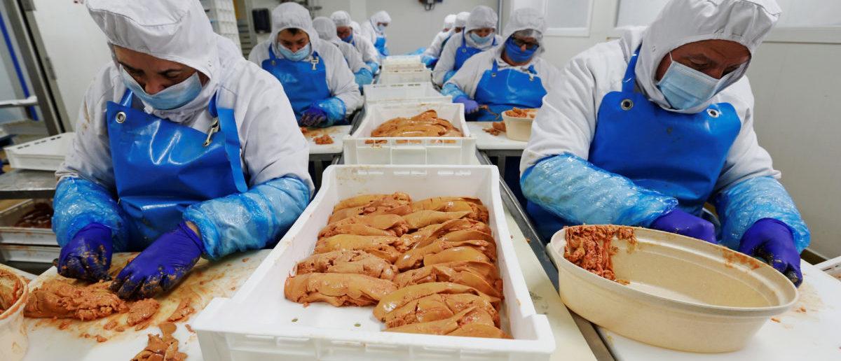 Employees prepare ducks livers, named foie gras, at the Maison Lafitte company factory in Montaut, France, January 10, 2019. REUTERS/Regis Duvignau