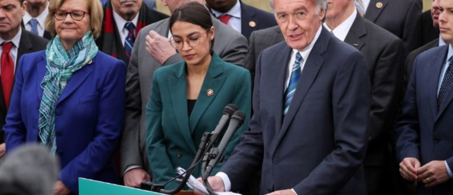 """FILE PHOTO: U.S. Representative Alexandria Ocasio-Cortez (D-NY) and Senator Ed Markey (D-MA) hold a news conference for their proposed """"Green New Deal"""" to achieve net-zero greenhouse gas emissions in 10 years, at the U.S. Capitol in Washington, U.S. February 7, 2019. REUTERS/Jonathan Ernst/File Photo"""
