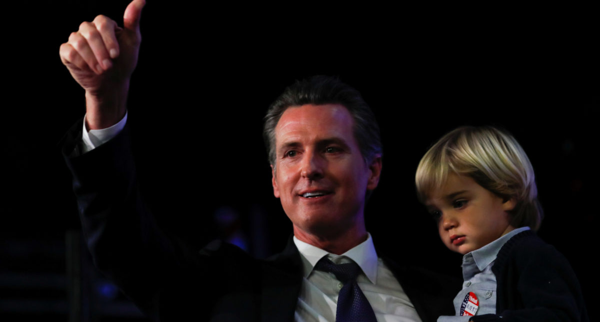 California Democratic gubernatorial candidate Gavin Newsom celebrates with his youngest son Dutch after being elected governor of the state during an election night party in Los Angeles, California, U.S. November 6, 2018. REUTERS/Mike Blake