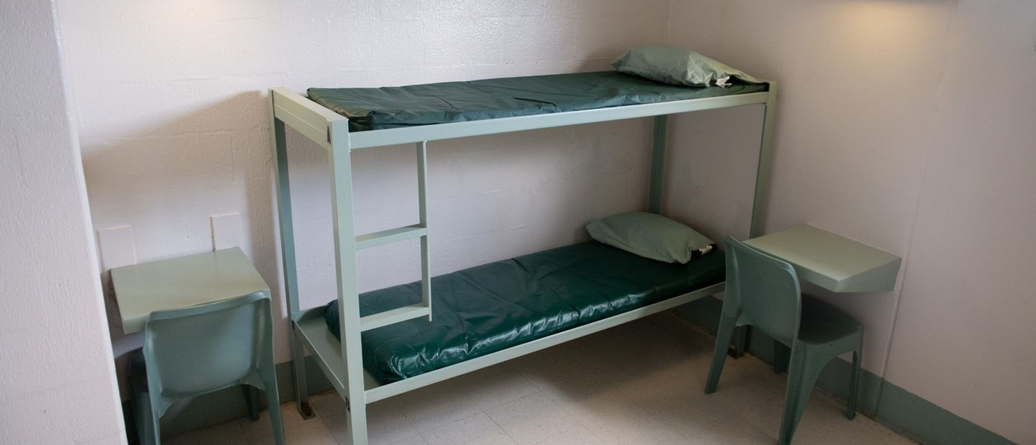 A bunk bed and desks inside a cell is seen at the Caroline Detention Facility in Bowling Green, Virginia, on August 13, 2018. - A former regional jail, the facility has been contracted by the US Department of Homeland Security Immigration and Customs Enforcement (ICE) to house undocumented adult immigrant detainees for violations of immigration laws (Photo by SAUL LOEB/AFP/Getty Images)