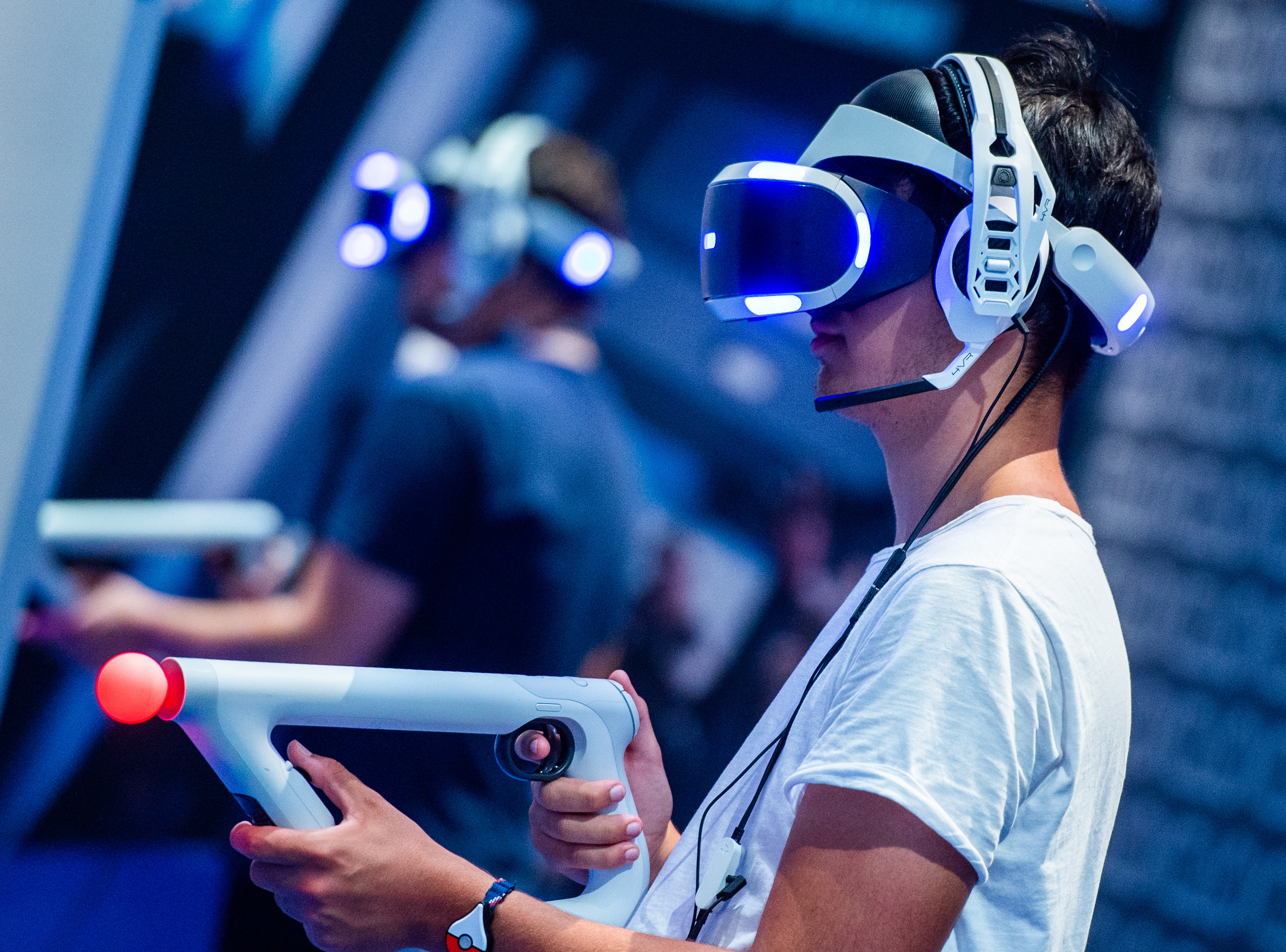 A visitor wearing VR glasses tries out a video game during the Gamescom convention on August 22, 2018 in Cologne, western Germany. -(CHRISTOPHE GATEAU/AFP/Getty Images)