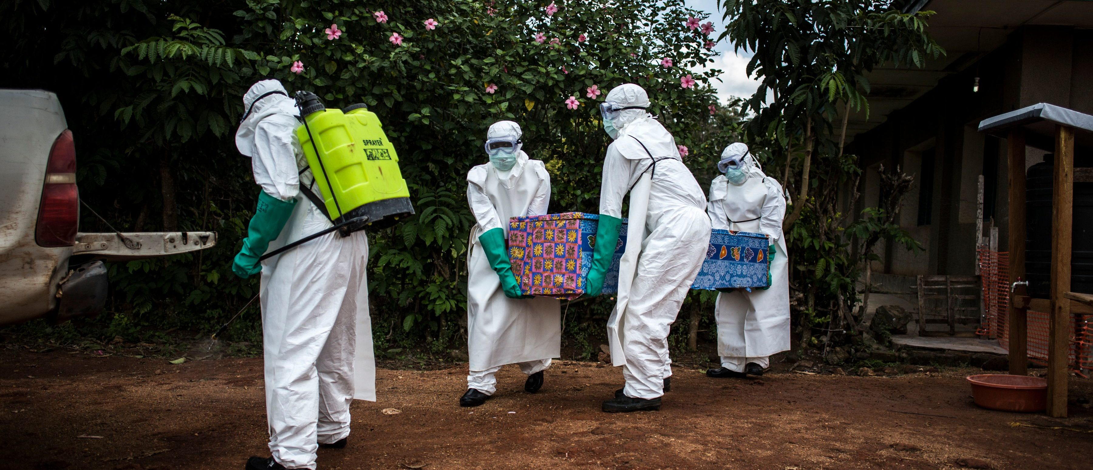 Health workers carry out the body of a patient with unconfirmed Ebola virus on August 22, 2018 in Mangina, near Beni, in the North Kivu province. (JOHN WESSELS/AFP/Getty Images)