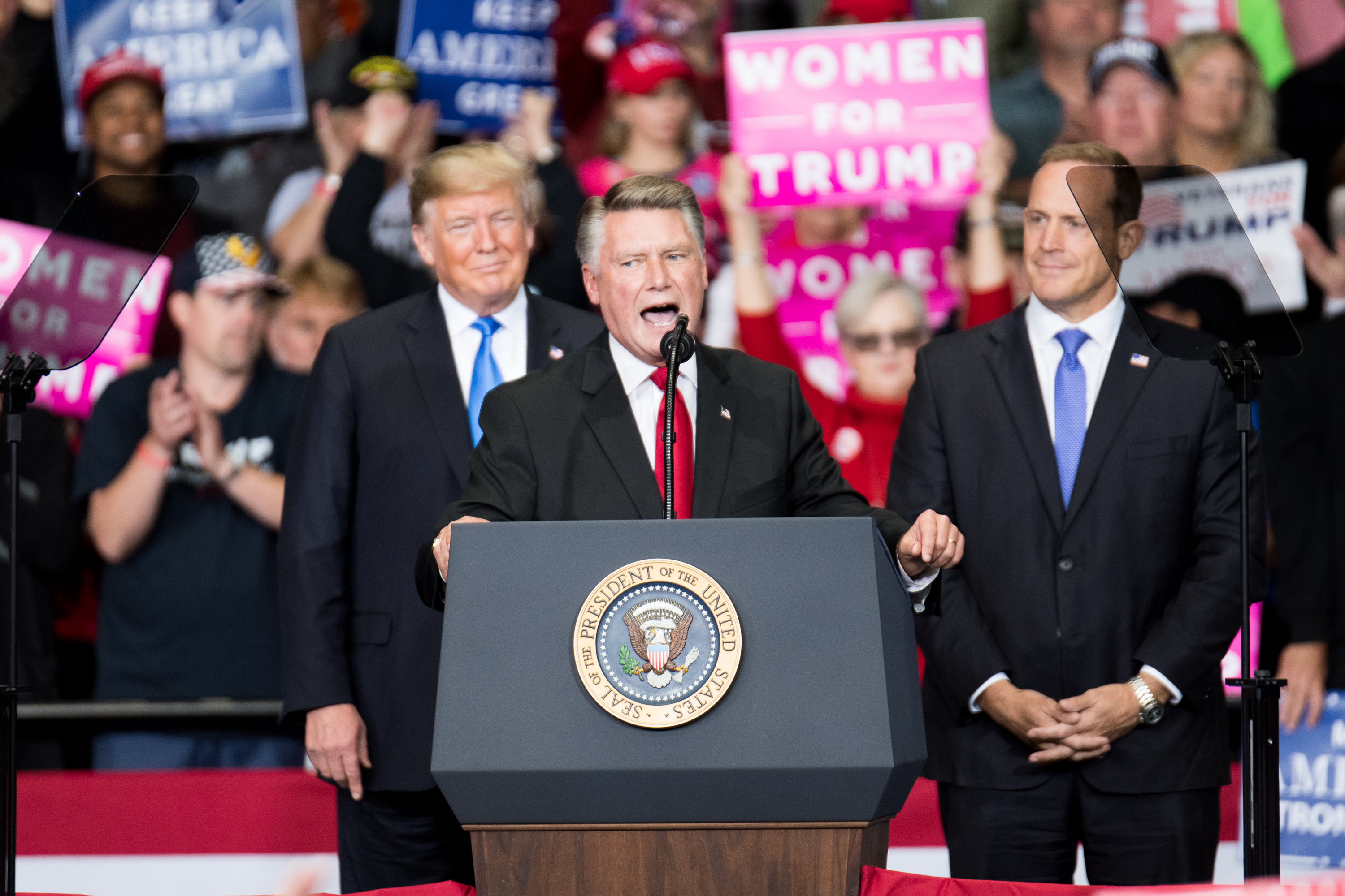 Republican Congressional candidate for North Carolina's 9th district Mark Harris (C), addresses the crowd as President Donald Trump (L) and Republican Congressional candidate for North Carolina's 13th district Ted Budd (R), listen at the Bojangles Coliseum on October 26, 2018 in Charlotte, North Carolina. (Photo by Sean Rayford/Getty Images)