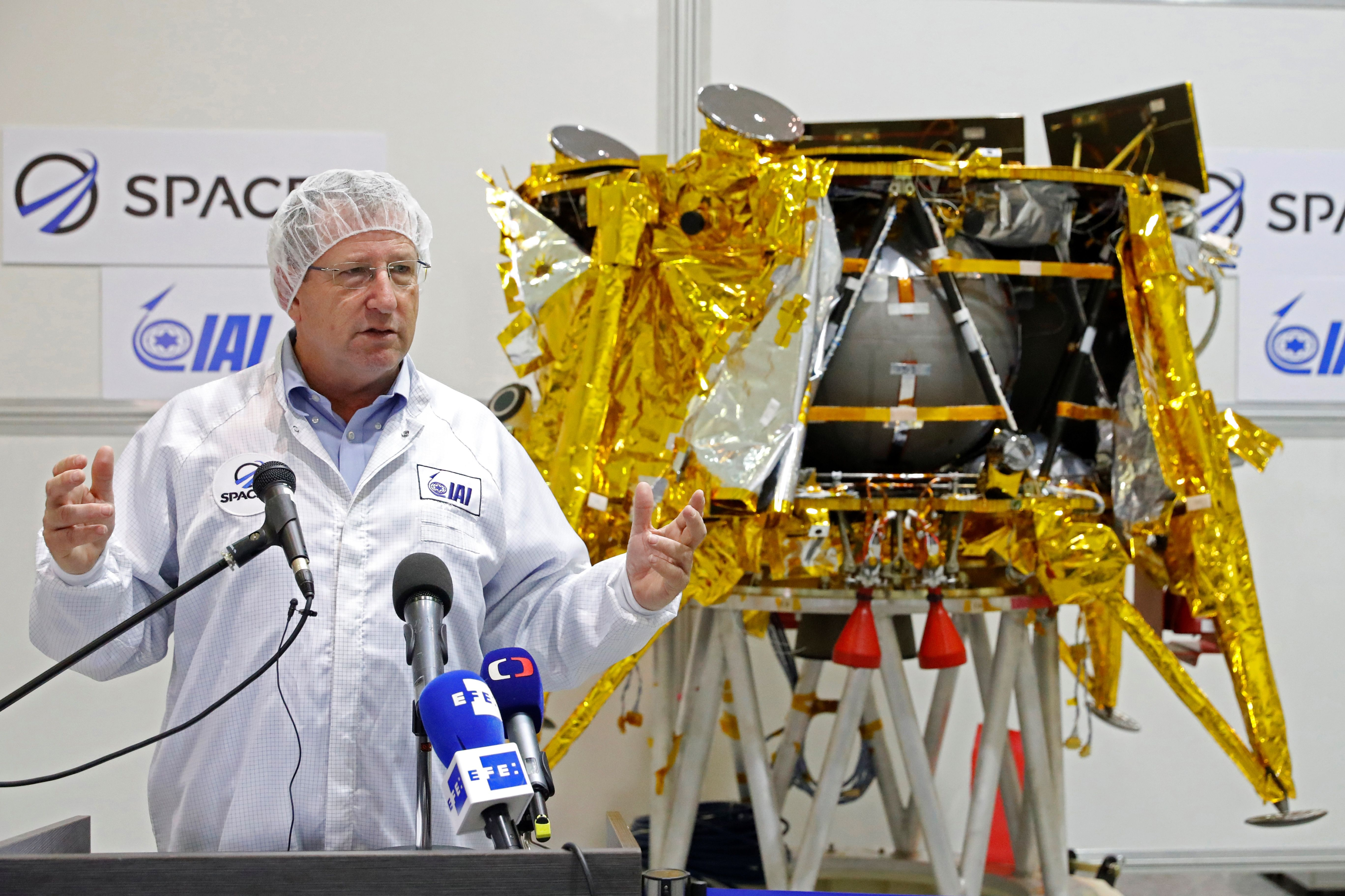 Israeli Aerospace Industries director of Space division Opher Doron speaks in front a a spacecraft weighing some 585 kilogrammes (1,300 pounds) during a presentation by Israeli nonprofit SpaceIL (JACK GUEZ/AFP/Getty Images)