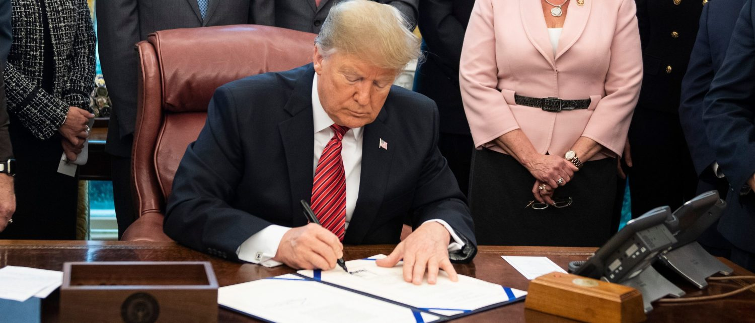 US President Donald Trump signs a bill for Anti-Human Trafficking Legislation at White House in Washington, DC, on January 9, 2018. - This legislation, which passed the House and Senate unanimously, would renew existing programs that make federal resources available to human trafficking survivors and establish new prevention, prosecution and collaboration initiatives to help bring the perpetrators to justice. (Photo: JIM WATSON/AFP/Getty Images)