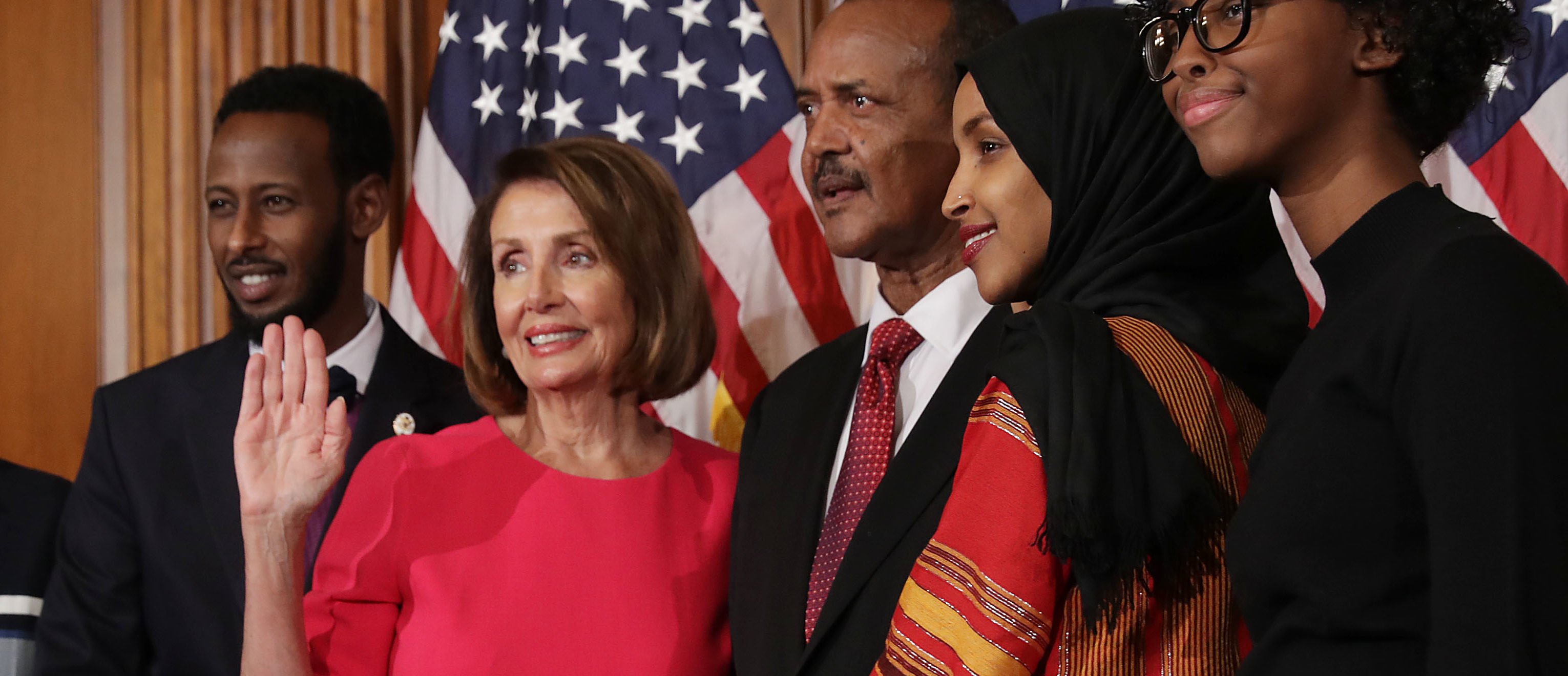 Speaker of the House Nancy Pelosi (D-CA) poses for photographs with Rep. Ilhan Omar (D-MN) and her family in the Rayburn Room at the U.S. Capitol January 03, 2019 in Washington, DC. (Photo by Chip Somodevilla/Getty Images)