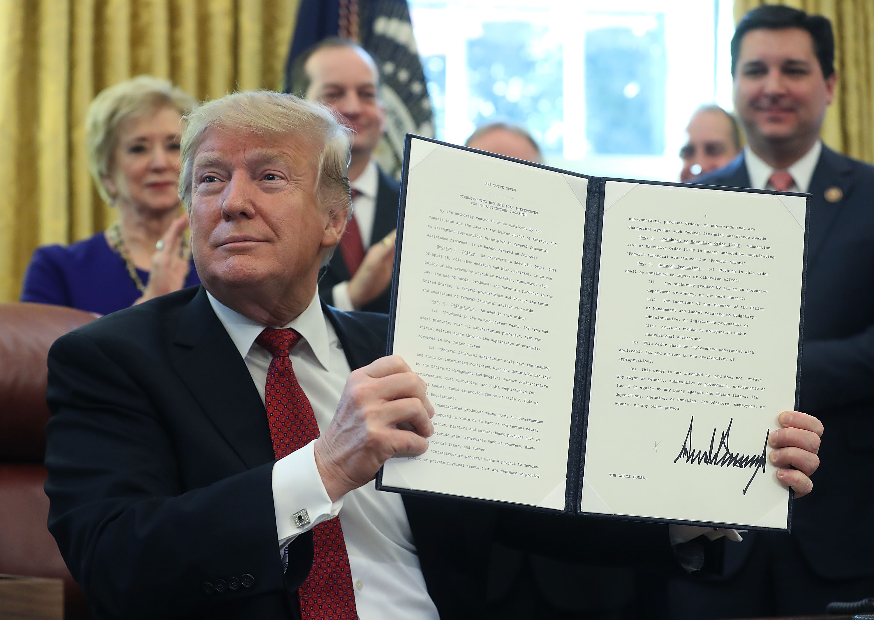 WASHINGTON, DC - JANUARY 31: U.S. President Donald Trump holds up an executive order he signed during a meeting with members of Congress and American manufacturers, to strengthen the administrationÕs buy American policy, in the Oval office on January 31, 2019 in Washington, DC. (Photo by Mark Wilson/Getty Images)
