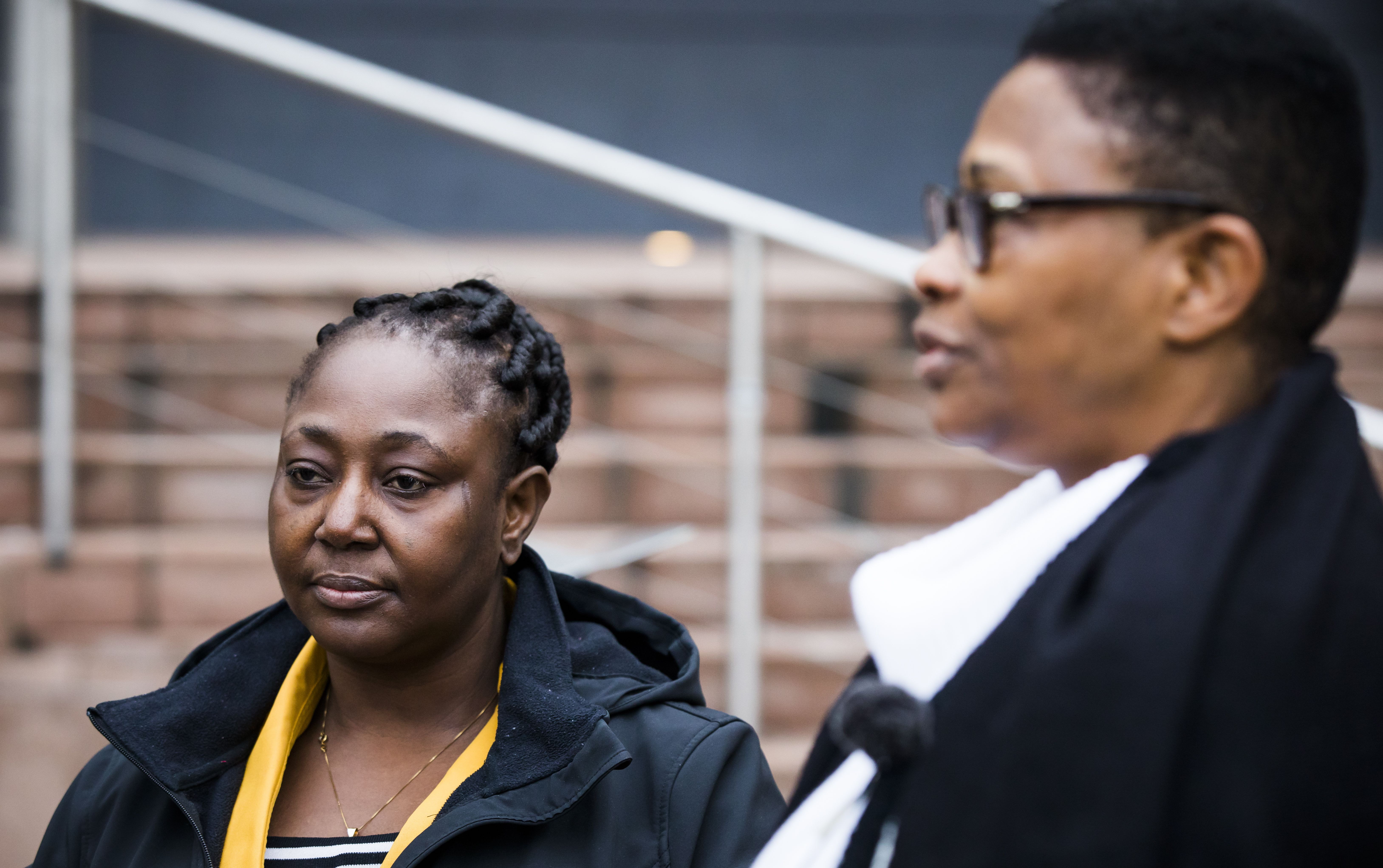 Victoria Bera (L) and Esther Kiobel, two of the widows who's husbands died by executions in 1995, stand outside The Hague courthouse on February 12, 2019. (BART MAAT/AFP/Getty Images)