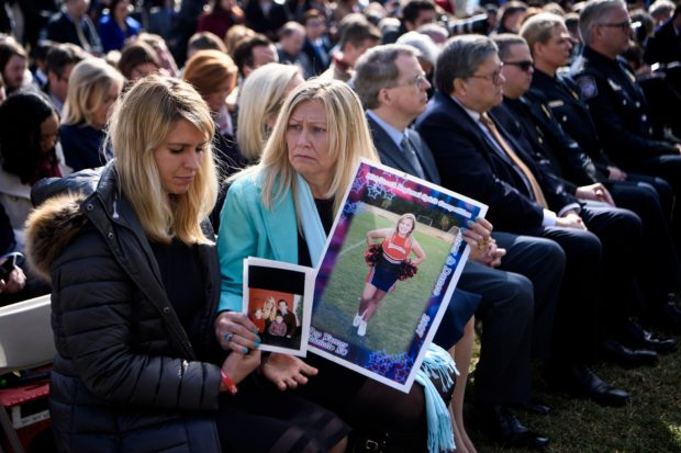"People who lost loved ones in crimes linked to illegal immigration listen while US President Donald Trump speaks about a state of emergency for a border wall from the Rose Garden of the White House February 15, 2019 in Washington, DC. - President Donald Trump, repeating his claim that ""walls work,"" announced that he will declare a national emergency in order to build a barrier on the US-Mexico border without funding from Congress. (Photo by Brendan Smialowski / AFP) (Photo credit should read BRENDAN SMIALOWSKI/AFP/Getty Images)"