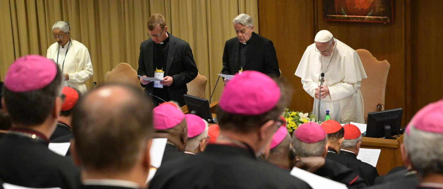 Pope Francis (R), flanked by Italian priest Federico Lombardi, prays during the opening of a global child protection summit for reflections on the sex abuse crisis within the Catholic Church, on February 21, 2019 at the Vatican. (VINCENZO PINTO/AFP/Getty Images)