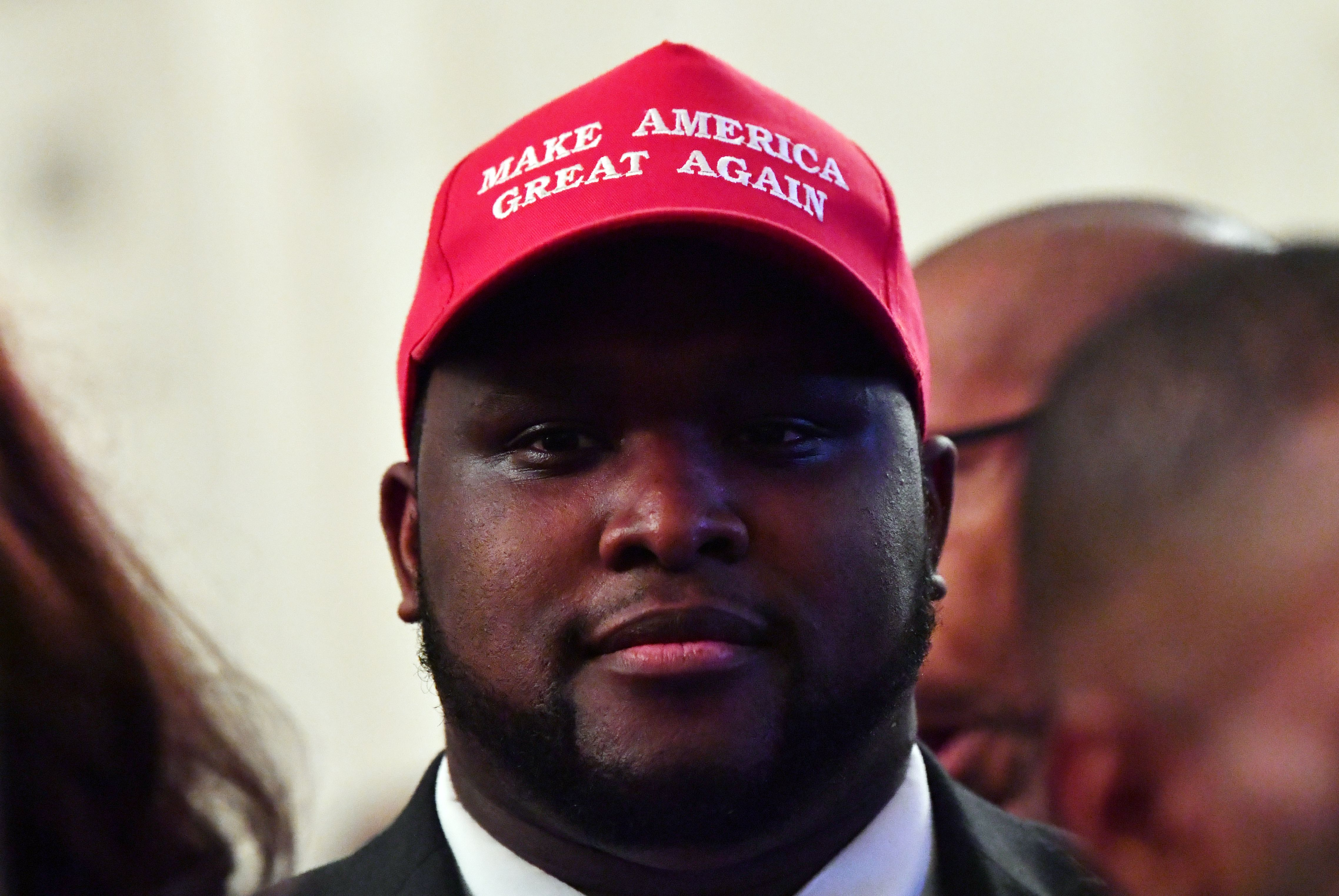 "A man wearing a ""Make American Great Again"" (MAGA) cap awaits the start of a White House reception in honor of National African American History Month hosted by US President Donald Trump and first lady Melania on February 21, 2019 in Washington, DC. (Photo by NICHOLAS KAMM/AFP/Getty Images)"