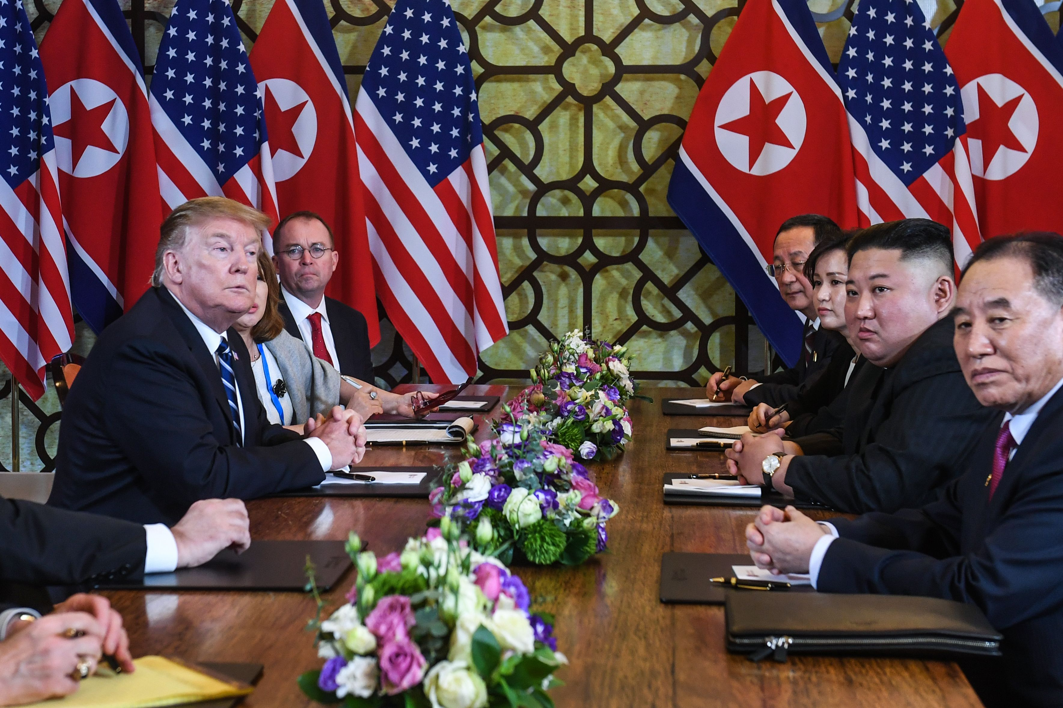 US President Donald Trump (L) and North Korea's leader Kim Jong Un (2nd R) hold a bilateral meeting during the second US-North Korea summit at the Sofitel Legend Metropole hotel in Hanoi on February 28, 2019. (Photo by SAUL LOEB/AFP/Getty Images)