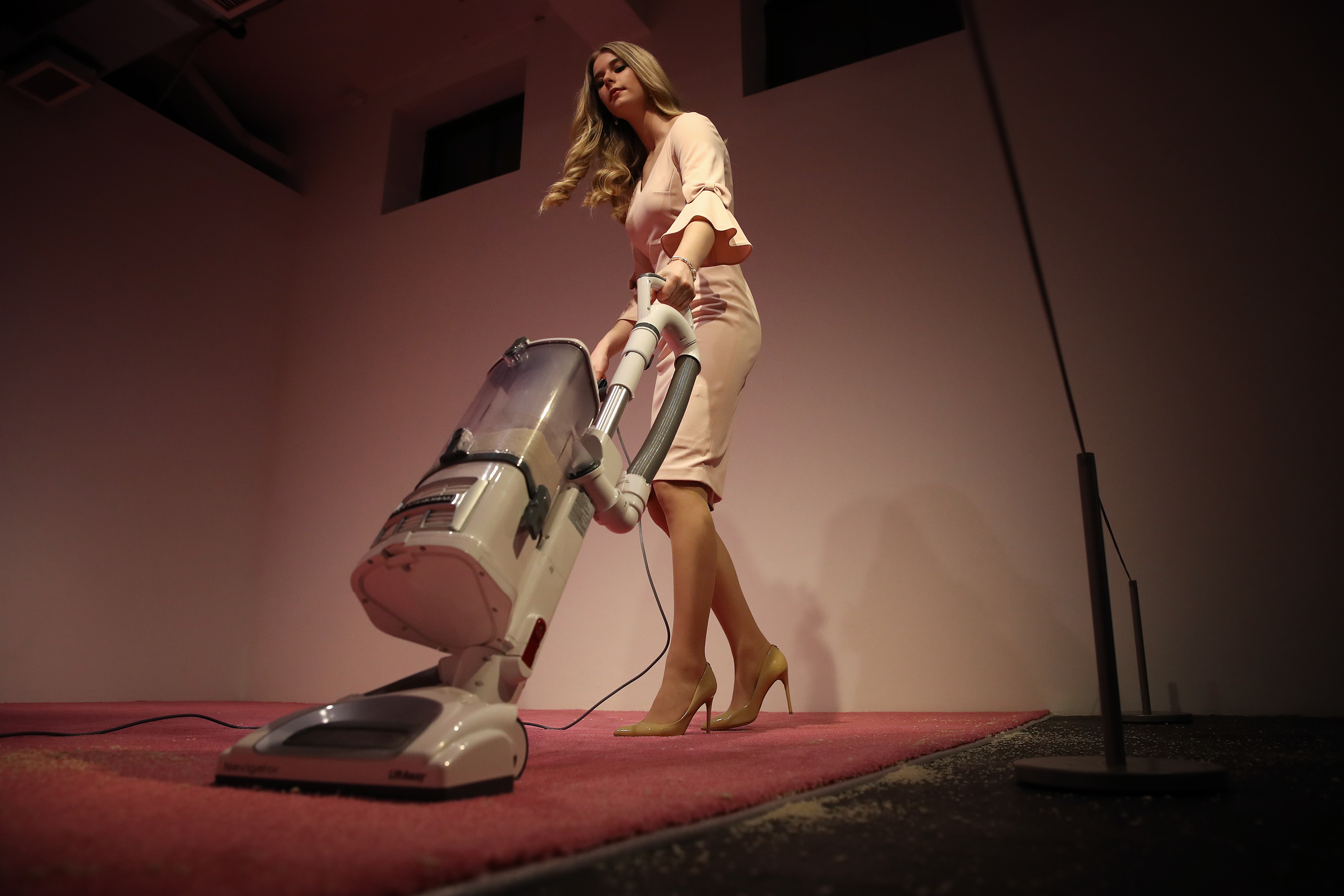 "An Ivanka Trump look-alike model vacuums bread crumbs thrown by visitors as part of an art installation titled ""Ivanka Vacuuming"" at the Flashpoint Gallery on February 07, 2019 in Washington, DC. (Photo by Win McNamee/Getty Images)"
