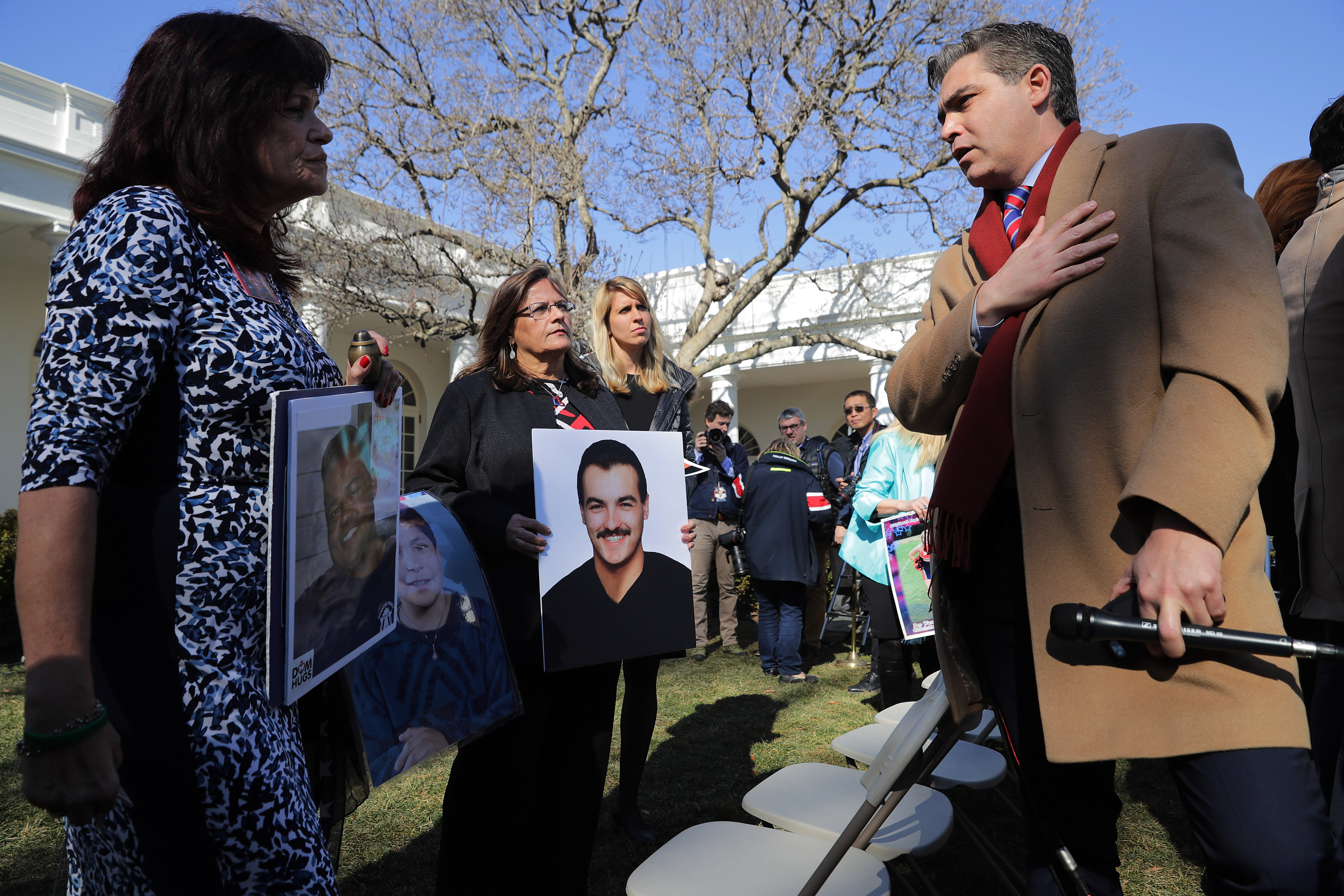 CNN's Jim Acosta (R) talks with 'Angel moms,' including Sabine Durden (L) ... (Photo by Chip Somodevilla/Getty Images)