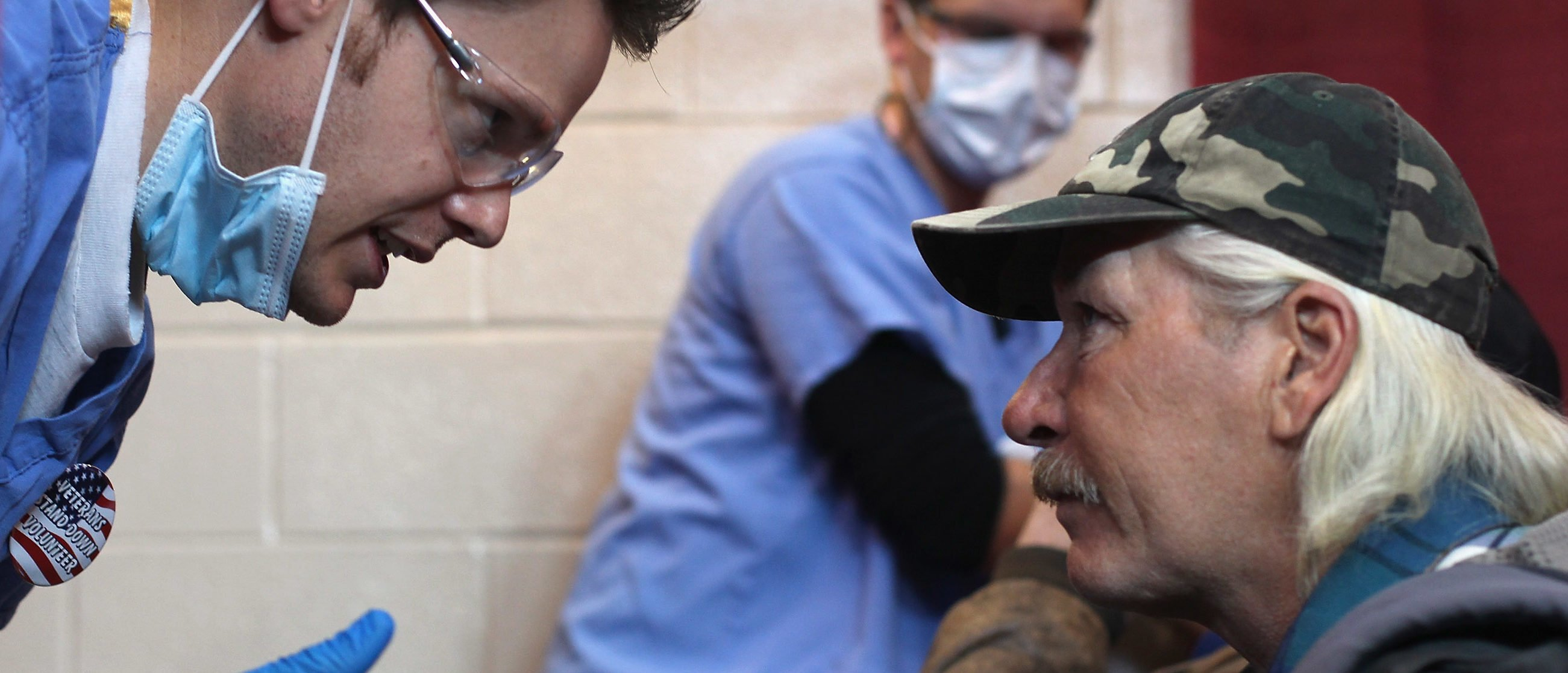 """Homeless U.S. Army veteran and unemployed carpenter Steven Wise (R), receives a dental checkup at a """"Stand Down"""" event hosted by the Department of Veterans Affairs on November 3, 2011 in Denver, Colorado. (Photo by John Moore/Getty Images)"""
