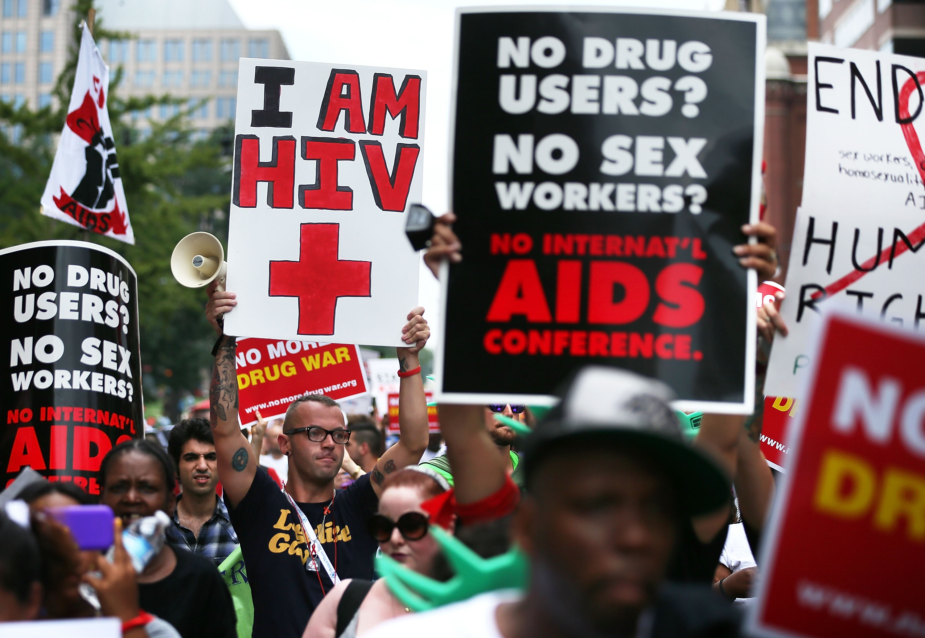 HIV+ patient Aaron Laxton (Center R) of St. Louis, Missouri, and other activists participate in a march from the Washington Convention Center to the White House July 24, 2012 in Washington, DC. (Photo by Alex Wong/Getty Images)
