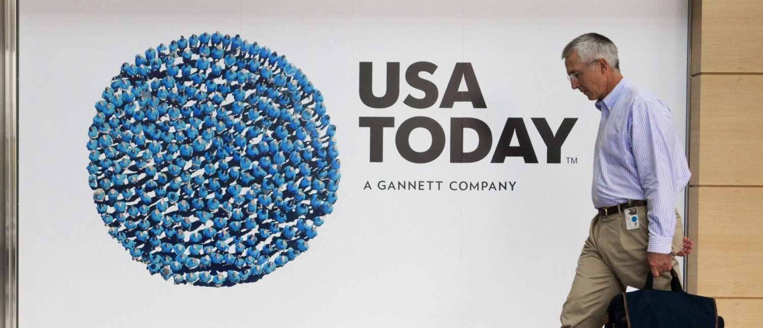 An unidentified man walks through the lobby of the Gannett-USA Today headquarters building August 20, 2013 on a 30-acre site in McLean, Virginia. (Photo credit: PAUL J. RICHARDS/AFP/Getty Images)