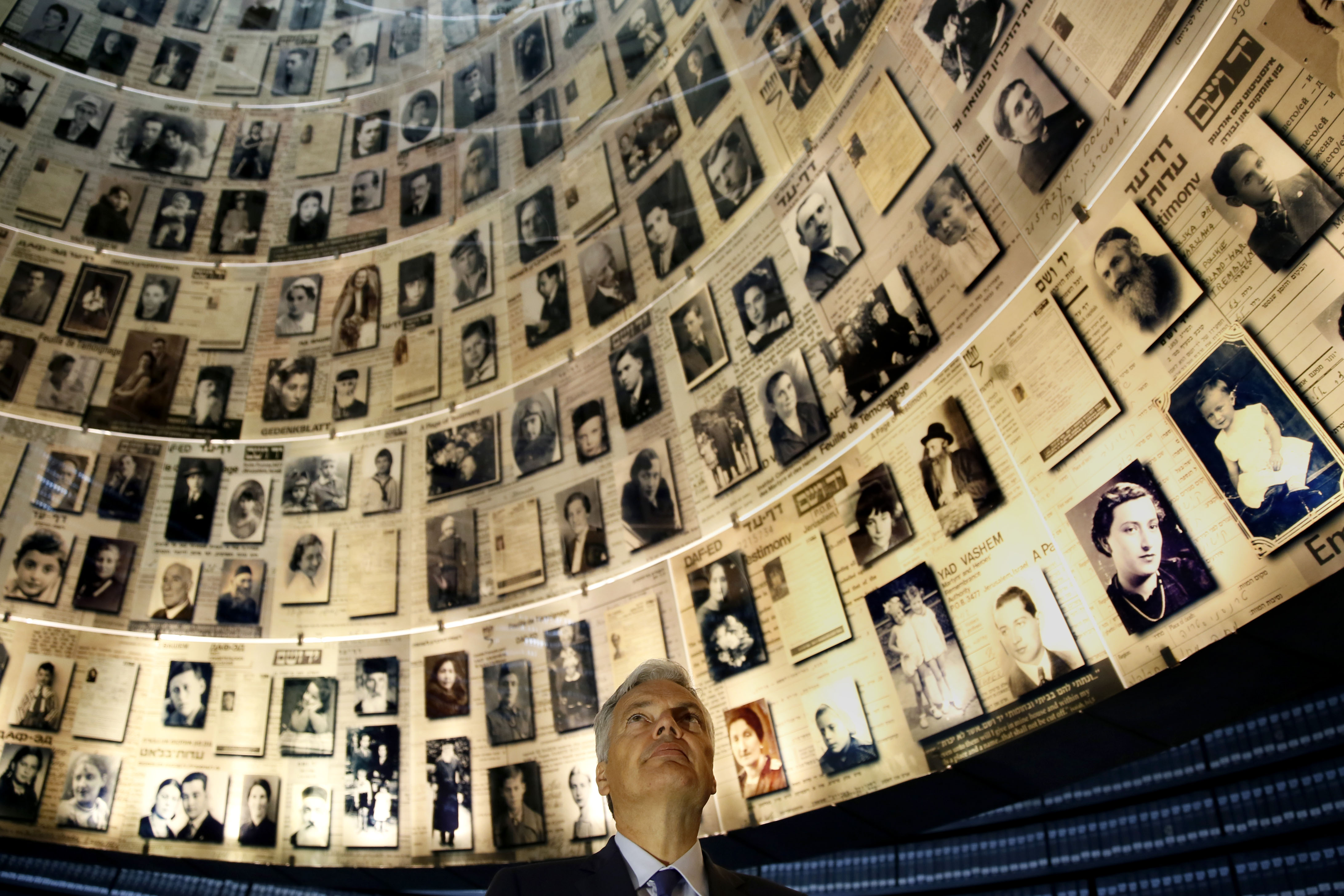 Belgian Foreign Minister Didier Reynders looks at pictures of Jewish Holocaust victims at the Hall of Names on November 12, 2013 during his visit to the Yad Vashem Holocaust Memorial museum in Jerusalem commemorating the six million Jews killed by the Nazis during World War II. (GALI TIBBON/AFP/Getty Images)