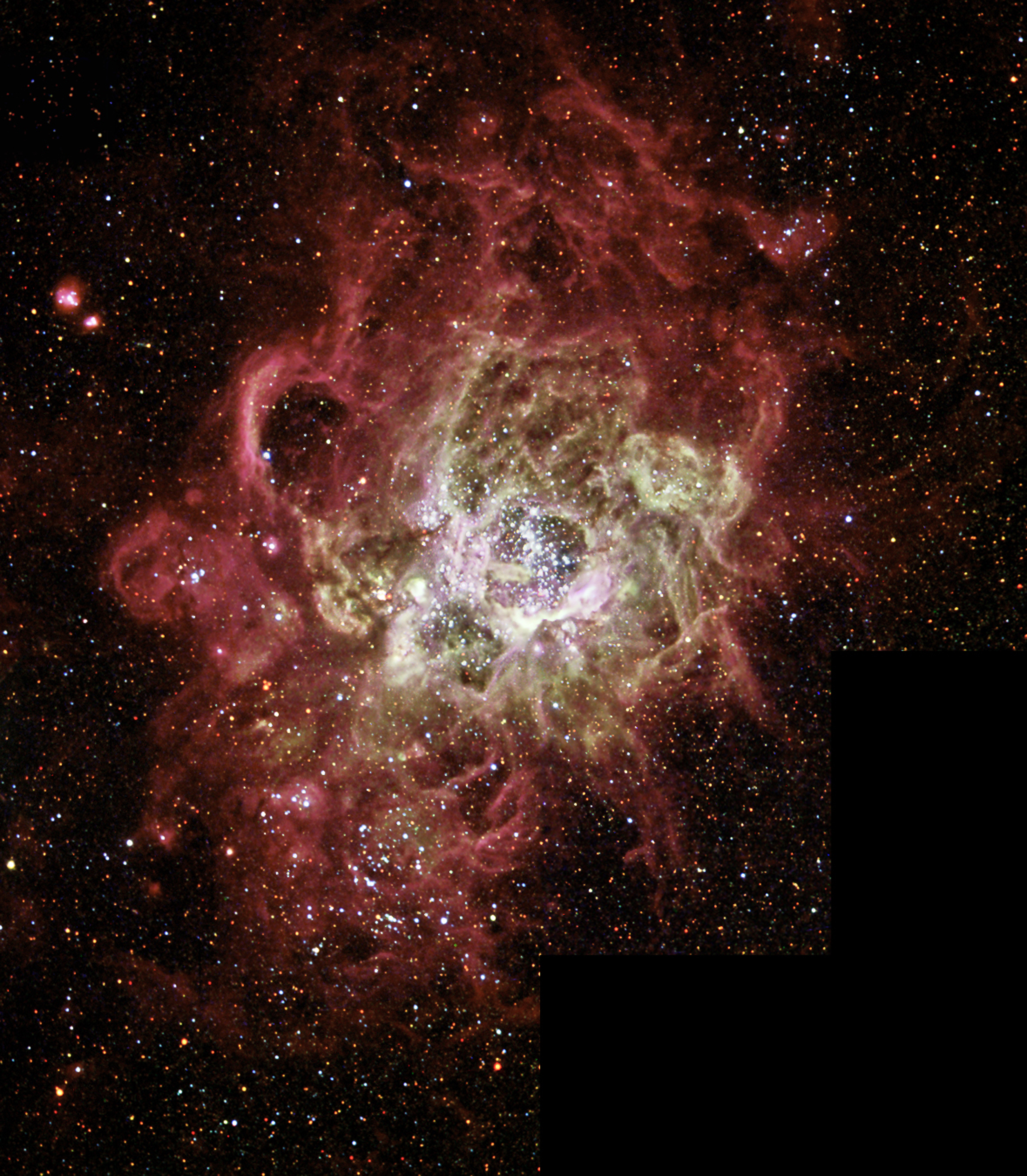 This festively colorful nebula, called NGC 604, is one of the largest known seething cauldrons of star birth in a nearby galaxy. (NASA via Getty Images)