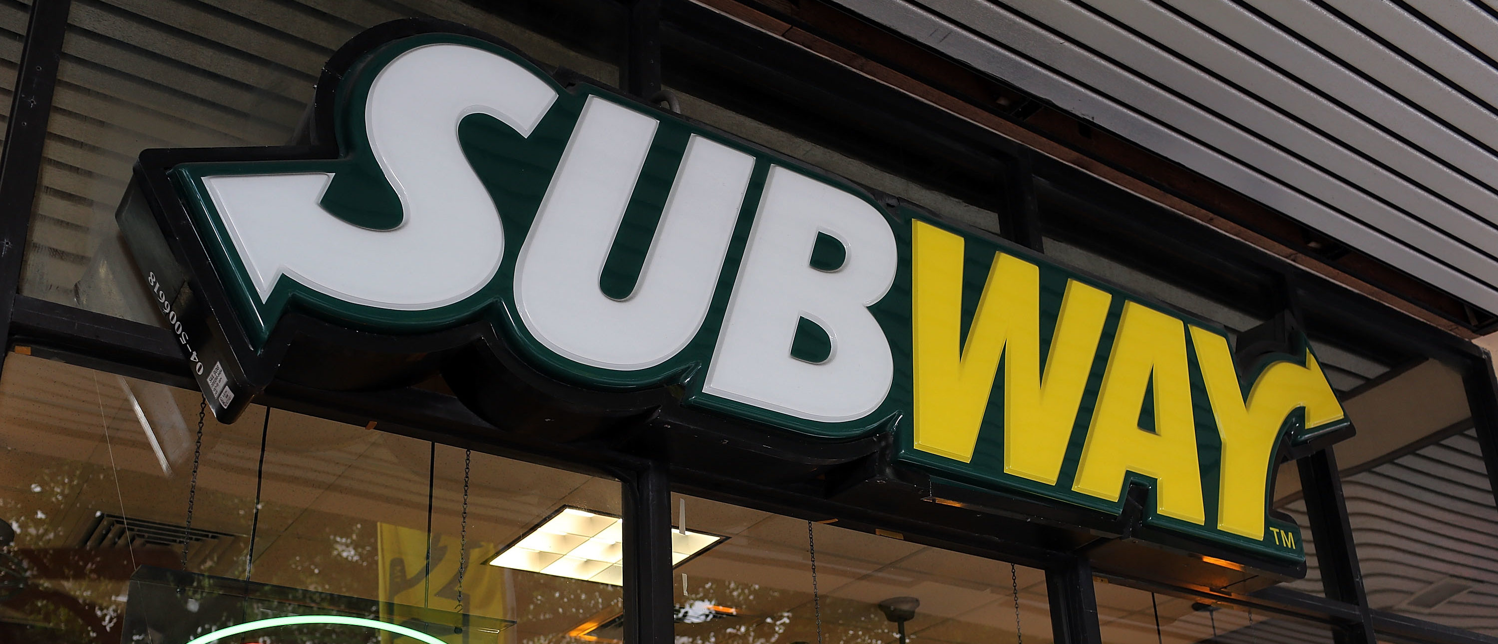 MIAMI, FL - OCTOBER 21: A Subway restaurant is seen as the company announced a settlement over a class-action lawsuit that alleged that Subway engaged in deceptive marketing for its 6-inch and 12-inch sandwiches and served customers less food than they were paying for on October 21, 2015 in Miami, Florida. (Joe Raedle/Getty Images)