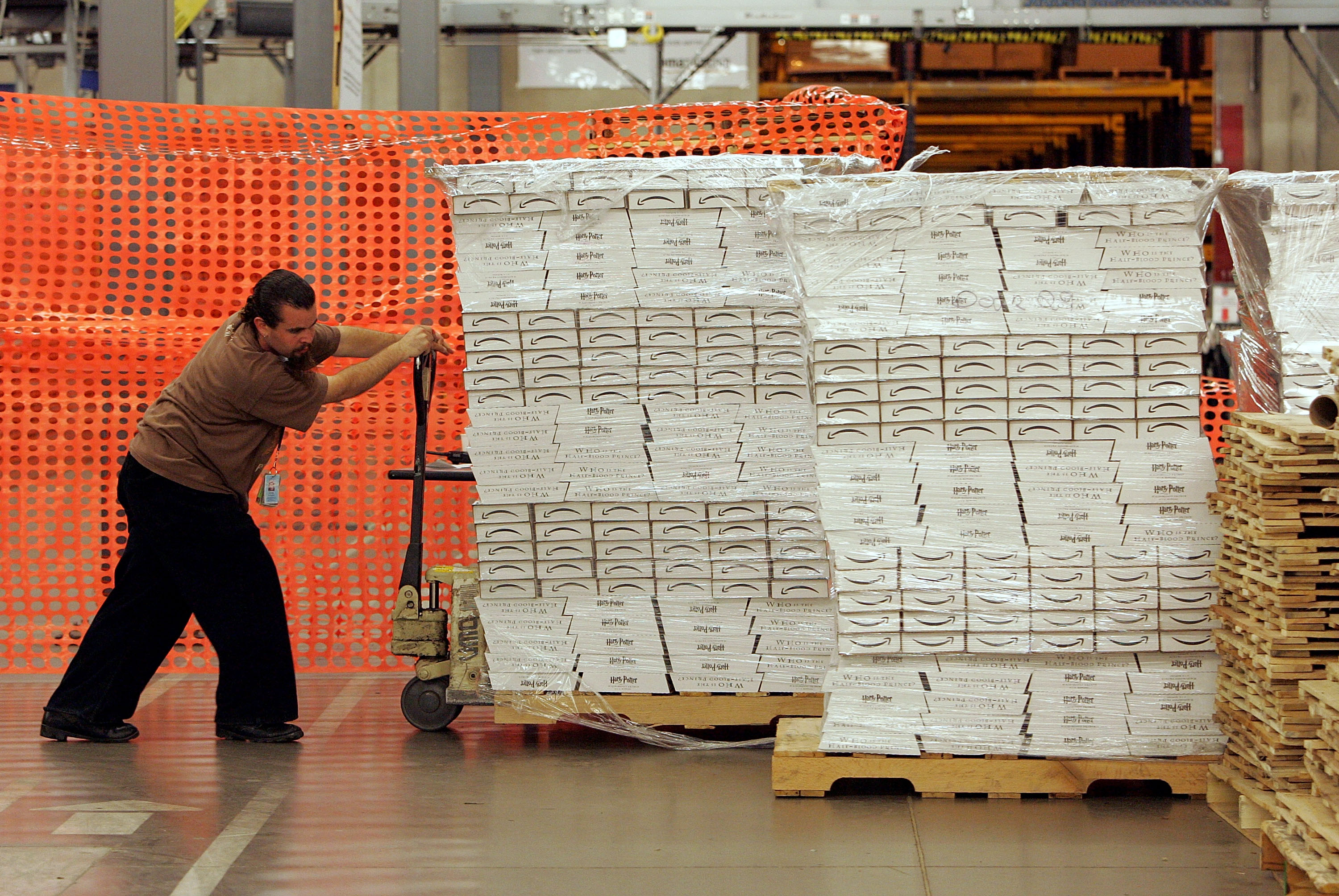 An Amazon.com worker Craig Strickland moves a pallet of pre-packaged copies of the new Harry Potter and the Half Blood Prince. (Photo by Justin Sullivan/Getty Images)